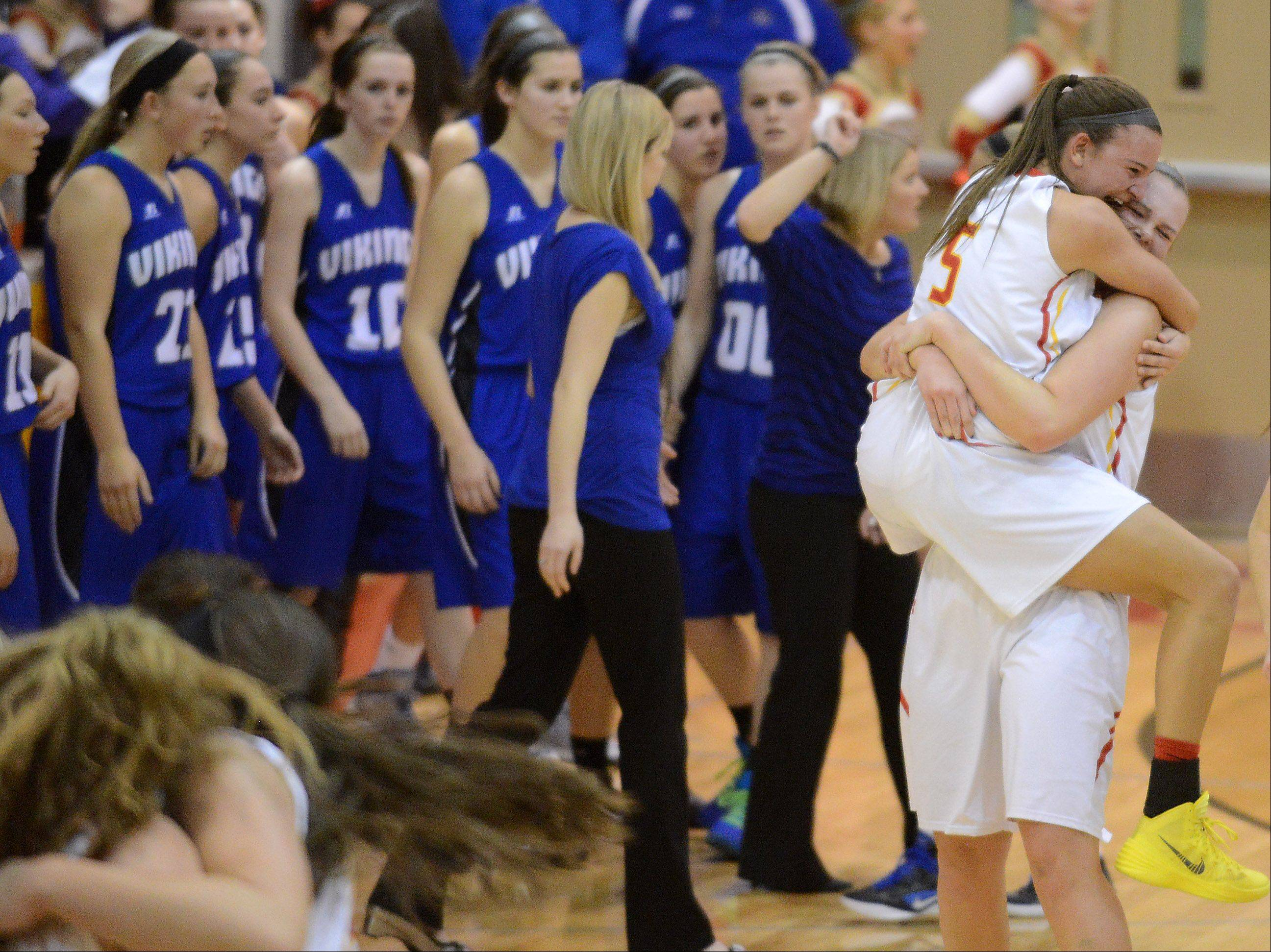 Batavia's Liza Fruendt jumps in to the arms of teammate Erin Bayram after a victory over Geneva.