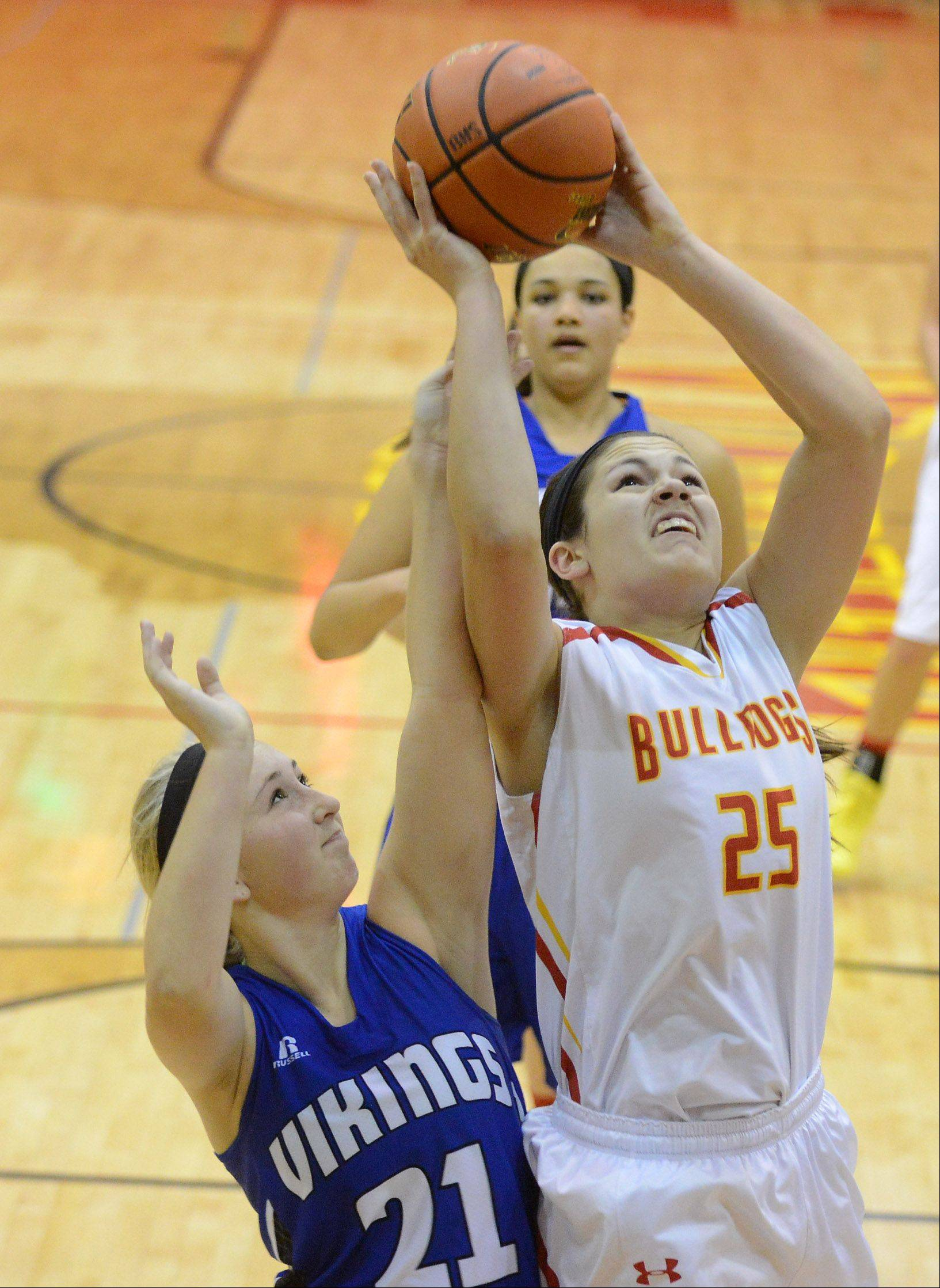 Batavia's Hannah Frazier puts up a shot with Geneva's Taylor Williams defending.