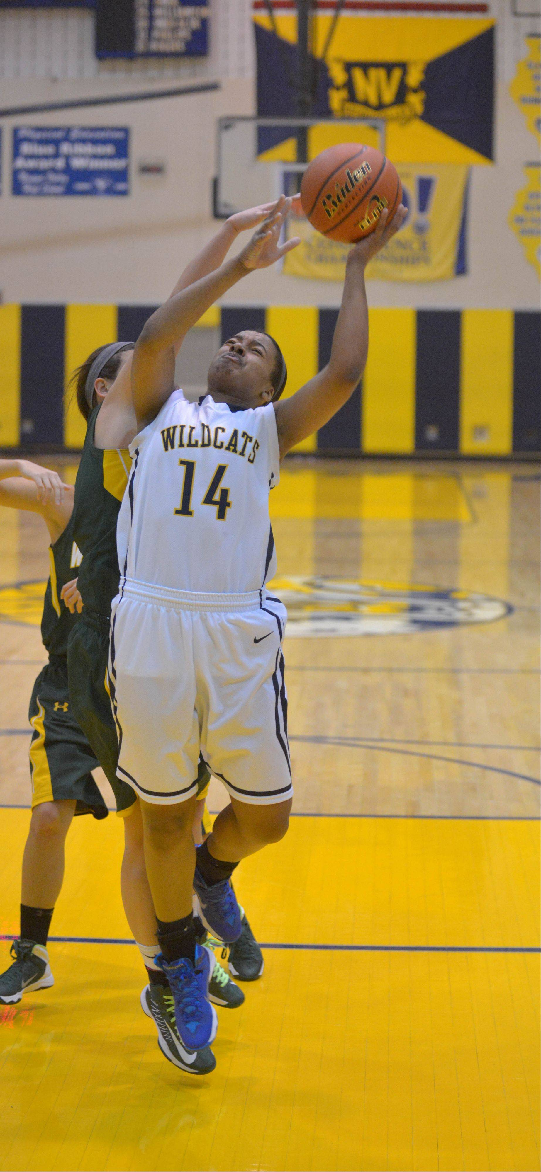 Najee Smith of Neuqua takes one to the net during the Waubonsie Valley at Neuqua Valley girls basketball game Saturday.
