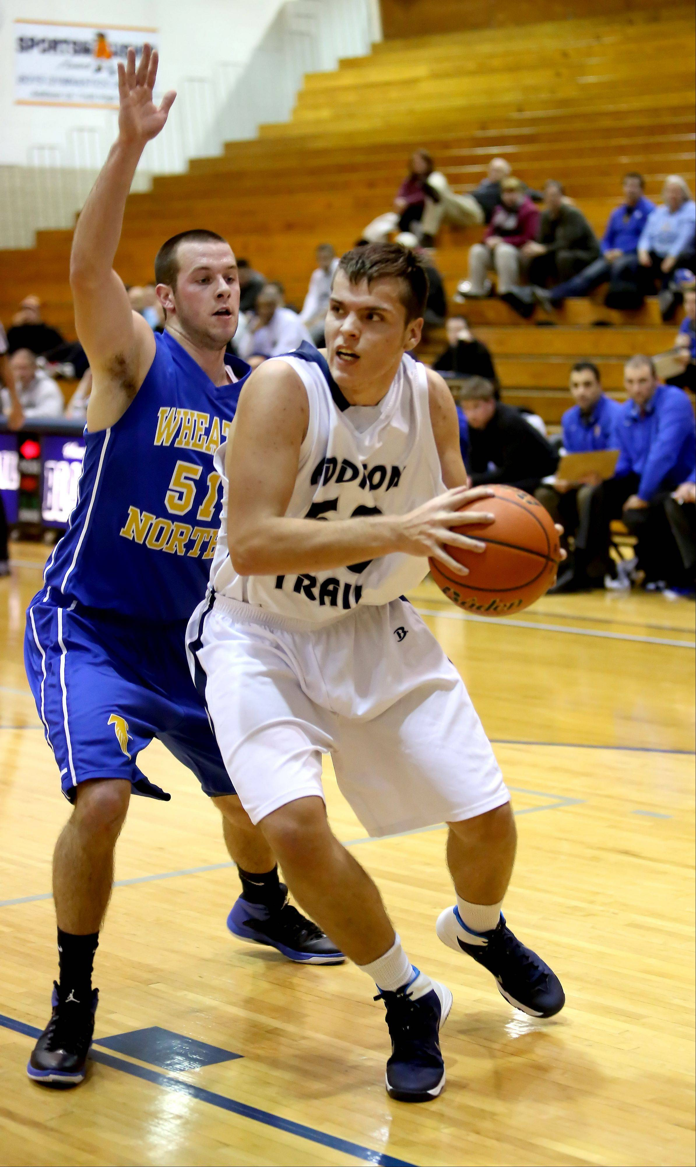 Simon Jakubczak of Addison Trail, left, moves around Matt Biegalski of Wheaton North.