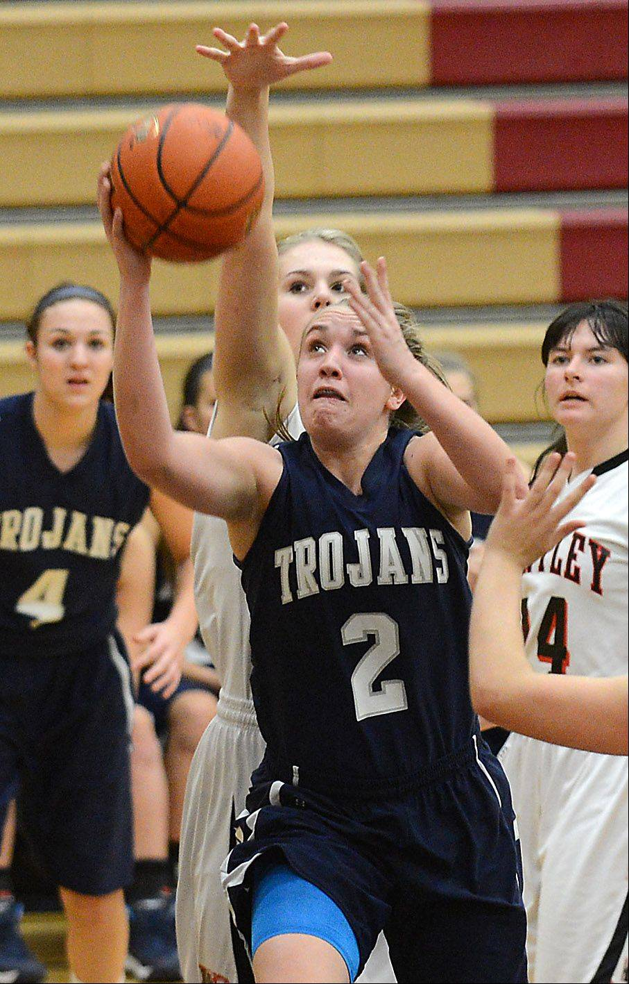 Cary-Grove's Katie Barker (2) drives to the basket during Monday's game in Huntley.