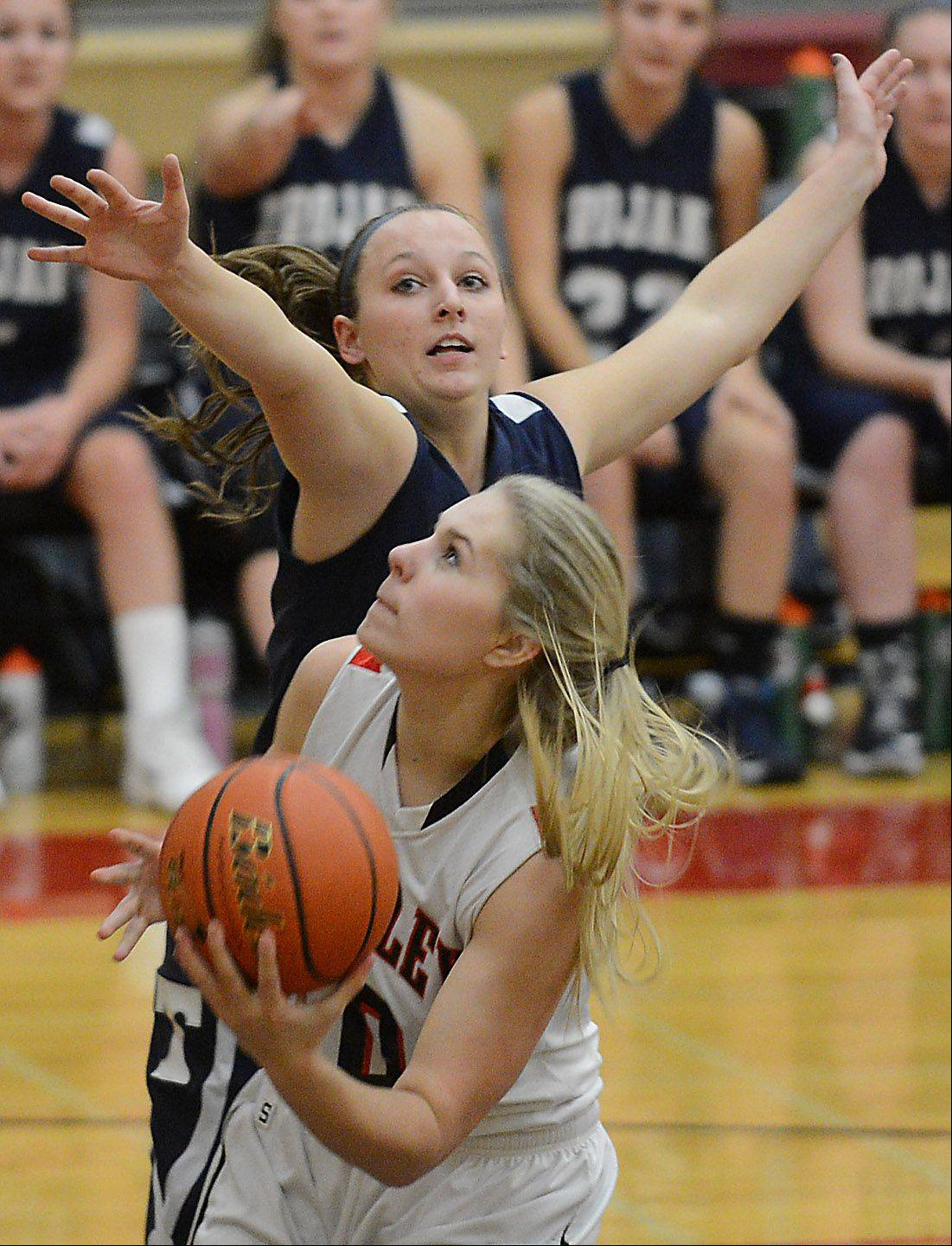 Huntley's Ali Andrews looks for a shot while being defended by Cary-Grove's Karisa Wilczynski .