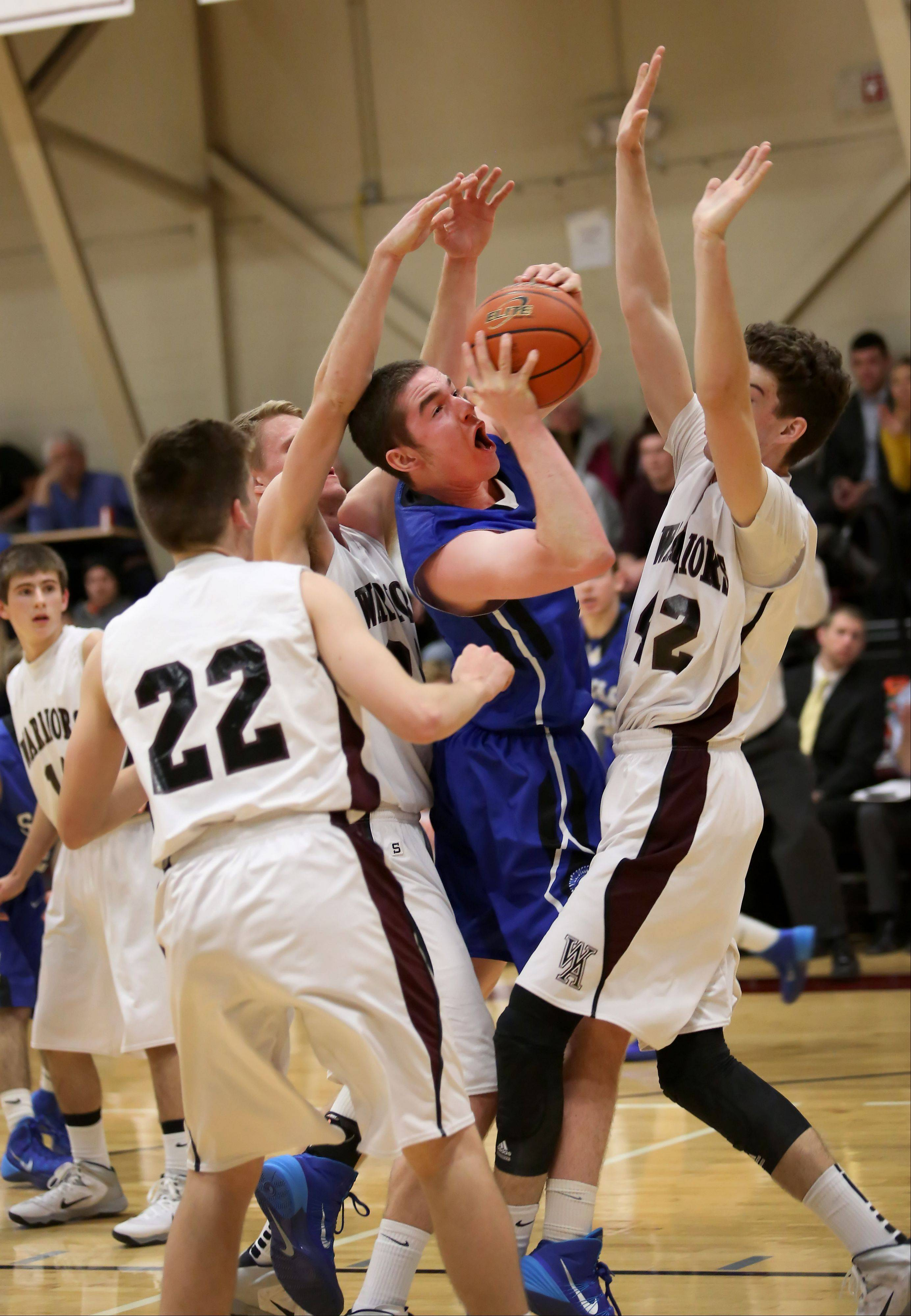 Wheaton Academy defense surrounds Kilian Brown of St. Francis as he tries to shoot the ball during boys basketball in West Chicago on Tuesday.