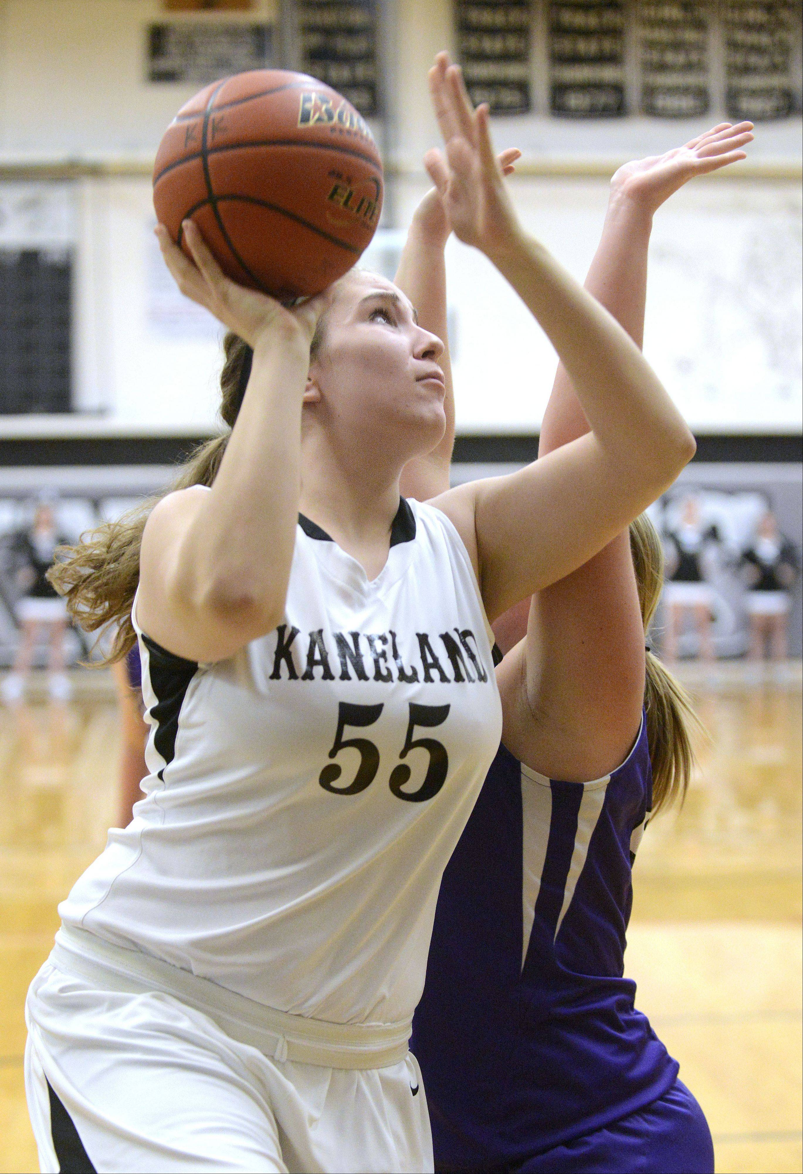Kaneland's Bailey Crimmins shoots past a block by Rochelle's Lizzie Miller in the second quarter on Tuesday, December 10.
