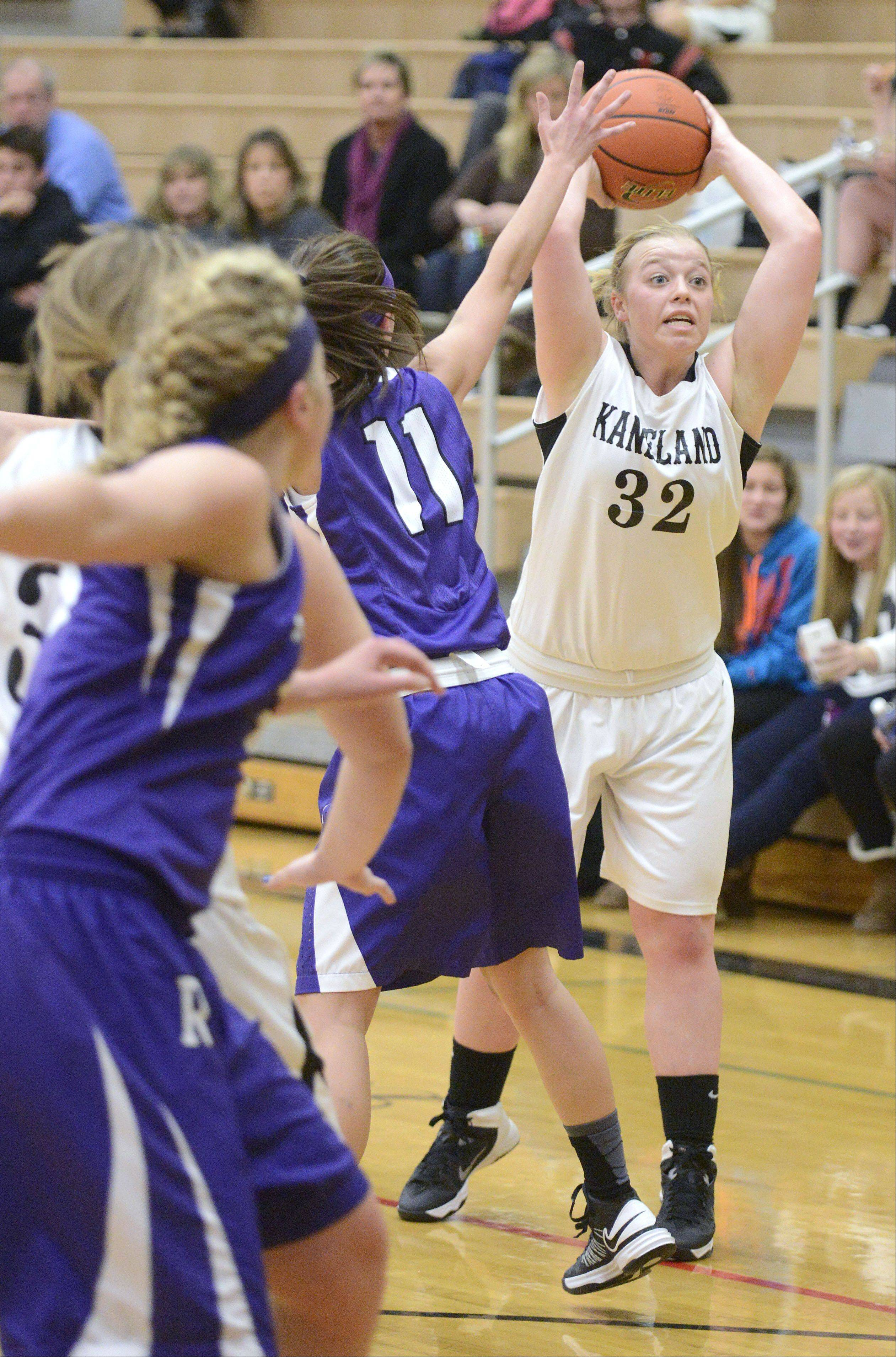 Rochelle's Anna Speed attempts to block a pass by Kaneland's Amber Winquist Bailey in the first quarter on Tuesday, December 10.