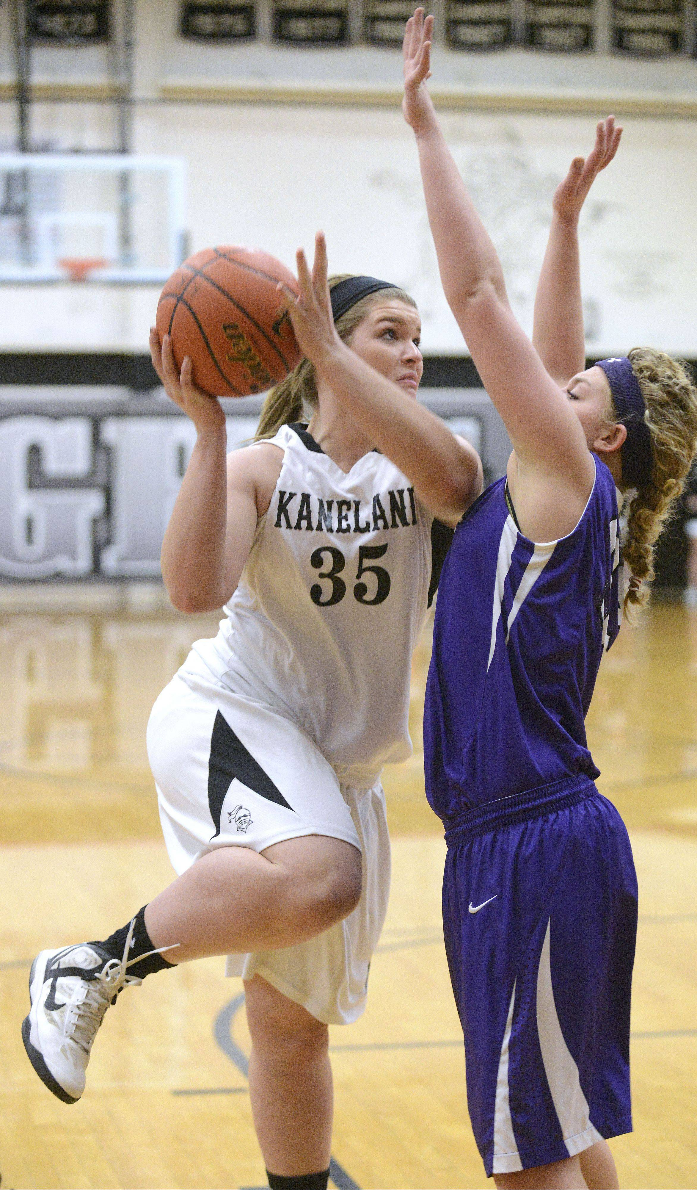 Kaneland's Brittany Kemp shoots over Rochelle's Lauren Murphy in the first quarter on Tuesday.
