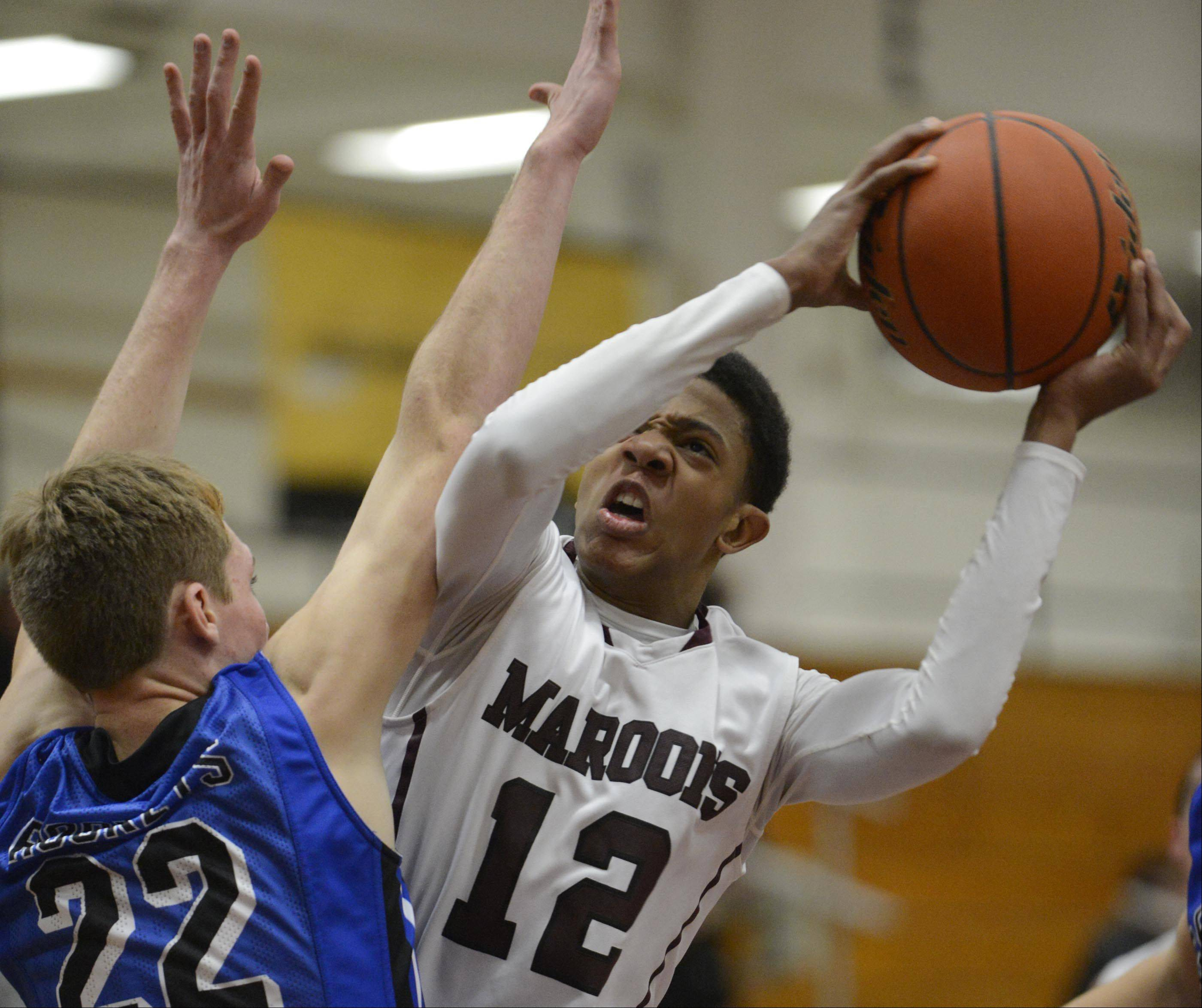 Elgin's Desmond Sanders is fouled by Burlington-Central's Sean Fitzgerald Tuesday in Elgin.