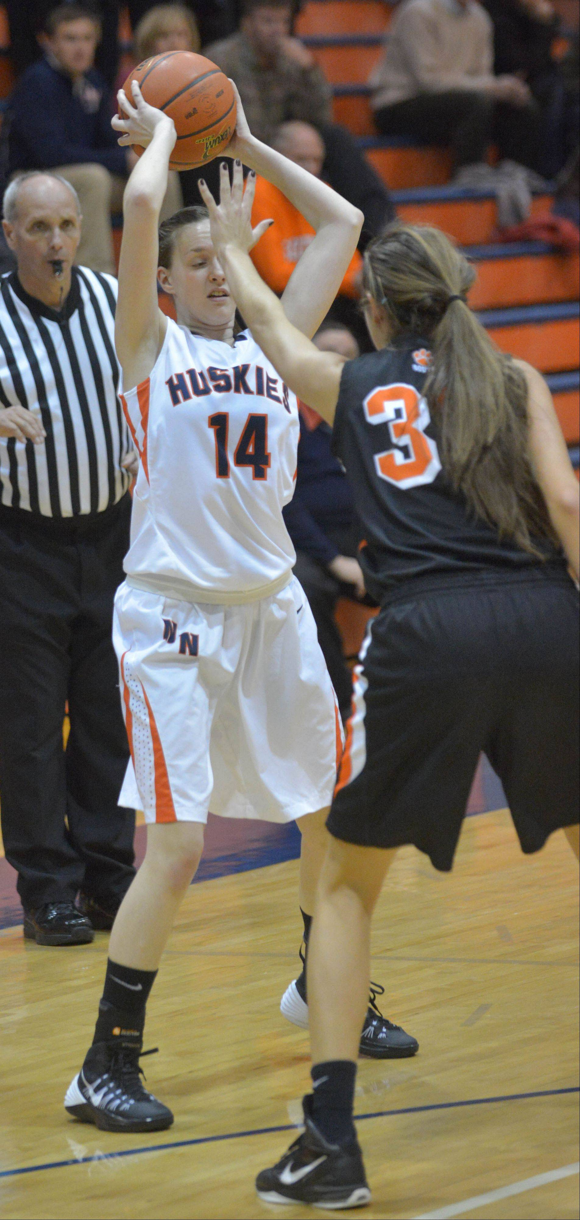 Sophia Fumagalli of Naperville North looks to pass during the Wheaton Warrenville South at Naperville North girls basketball game Tuesday.