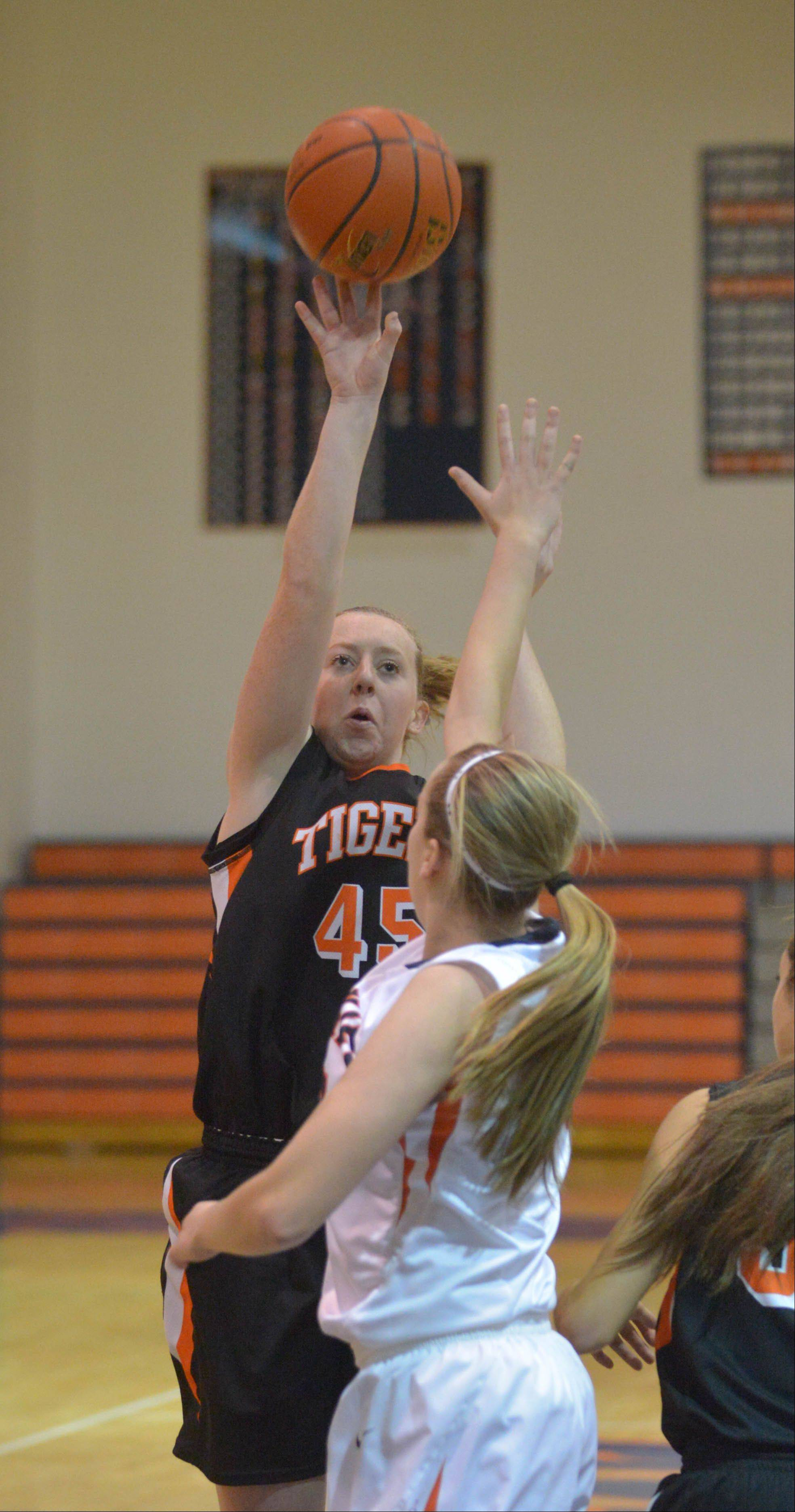 Meghan Waldron takes a shot during the Wheaton Warrenville South at Naperville North girls basketball game Tuesday.