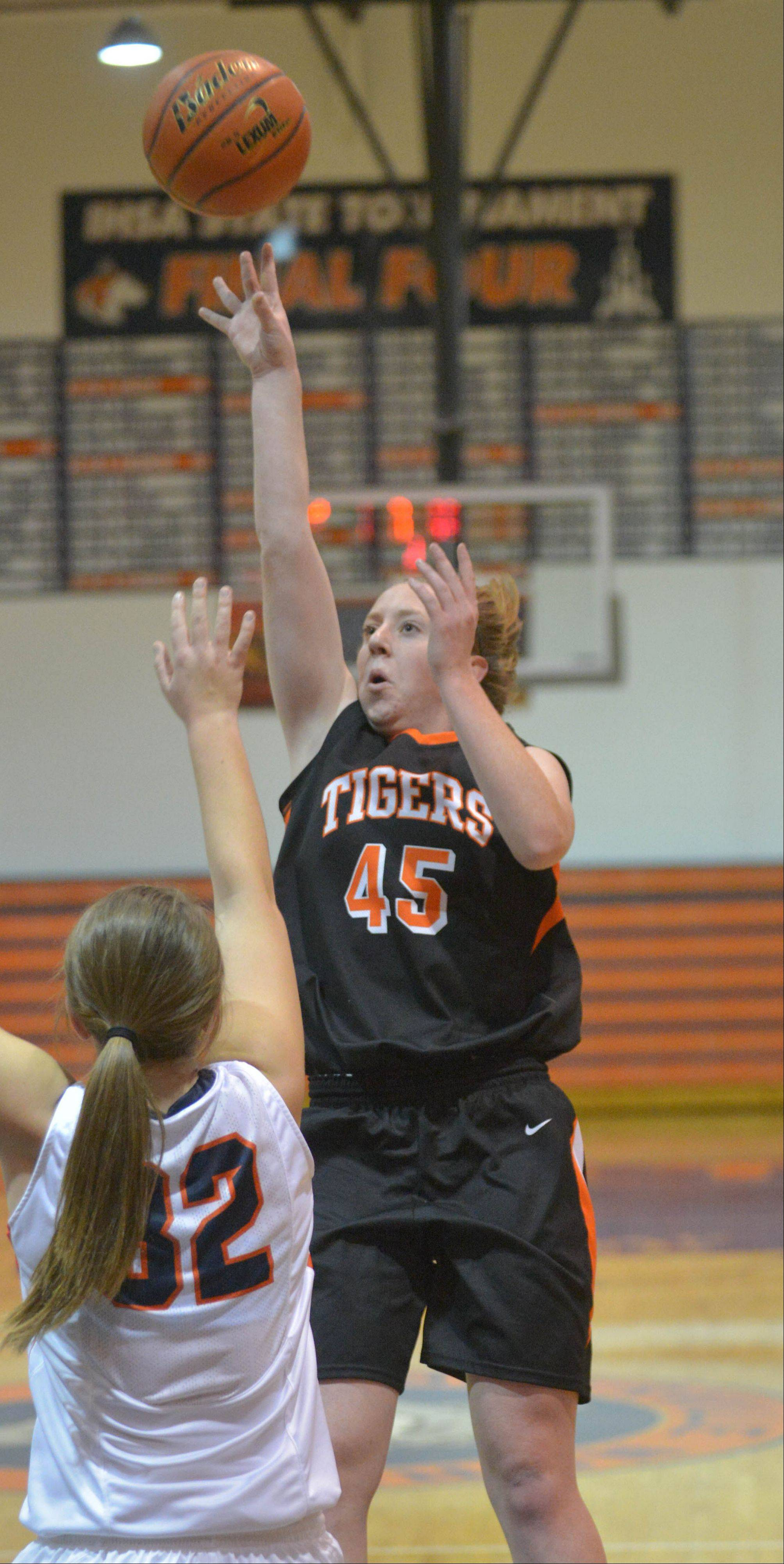 Meghan Waldron takes a shot over Morganne Freeman of Naperville North during the Wheaton Warrenville South at Naperville North girls basketball game Tuesday.
