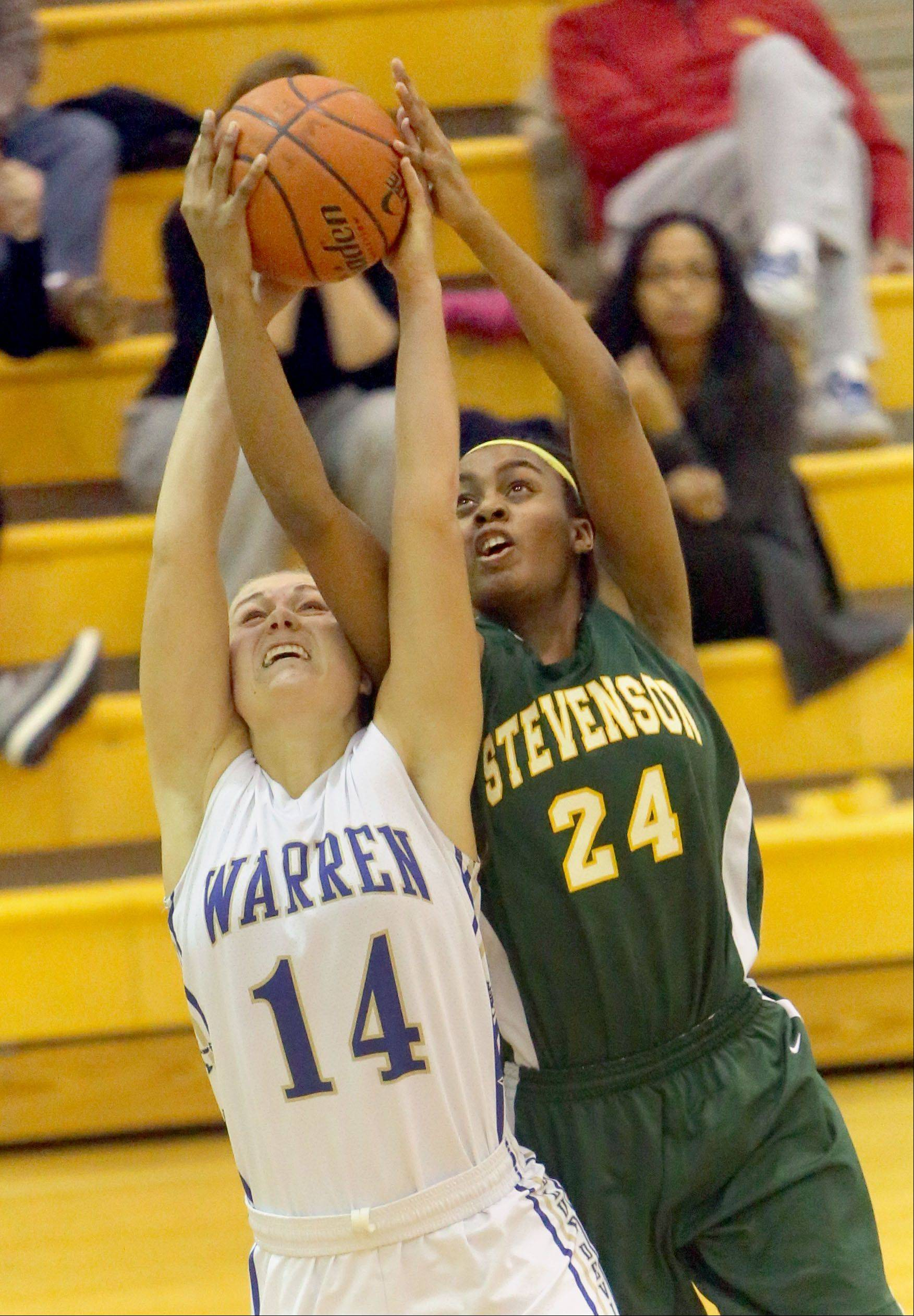 Warren's Kristen O'Brien, left and Stevenson's Taylor Buford battle for a rebound Tuesday night in Gurnee.