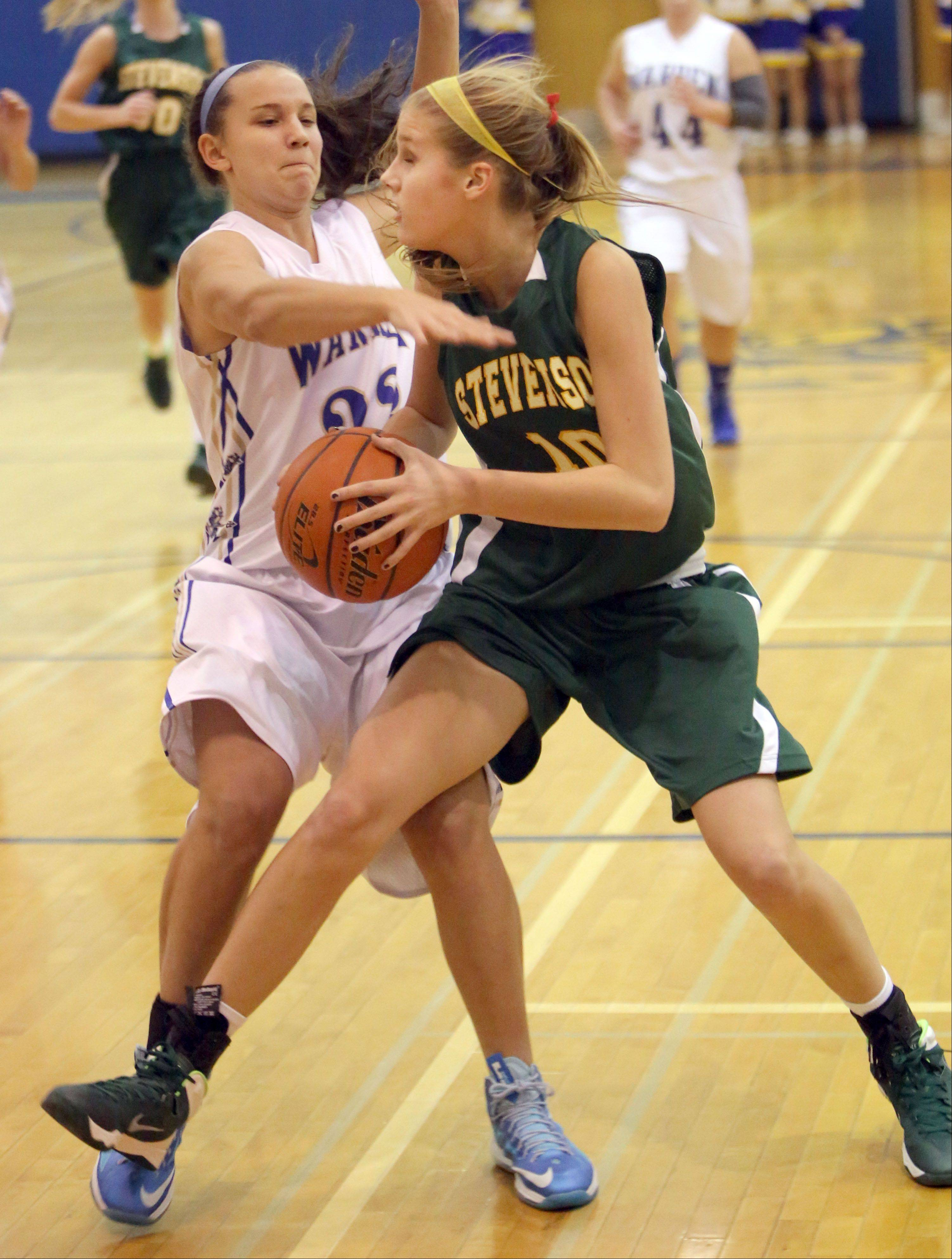 Stevenson's Chloe Ekenberg, right, drives on Warren's Danielle Cassidy on Tuesday night in Gurnee.