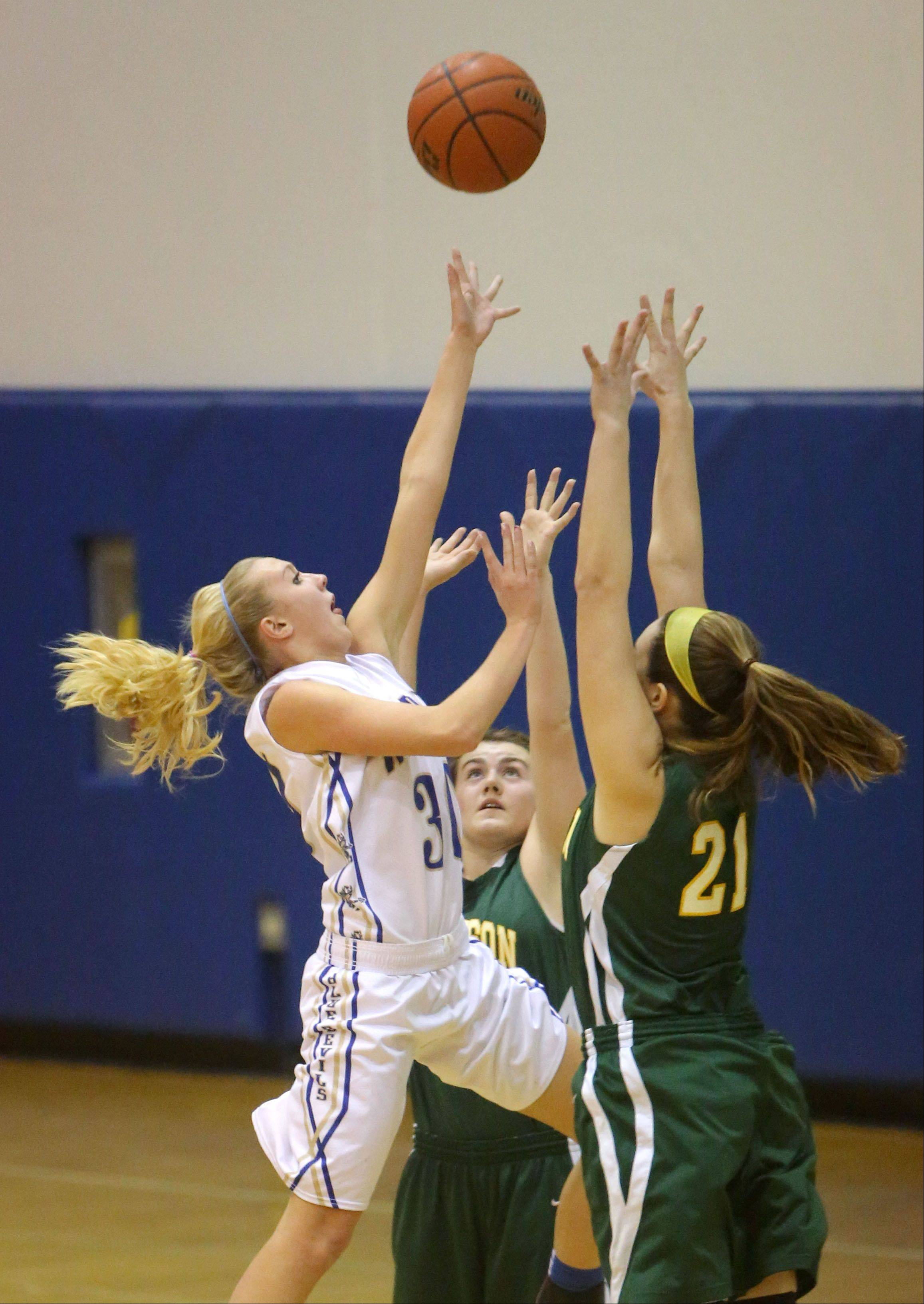 Warren's Sami Jo Nixon drives on Stevenson's Melanie Despinich on Tuesday night in Gurnee.