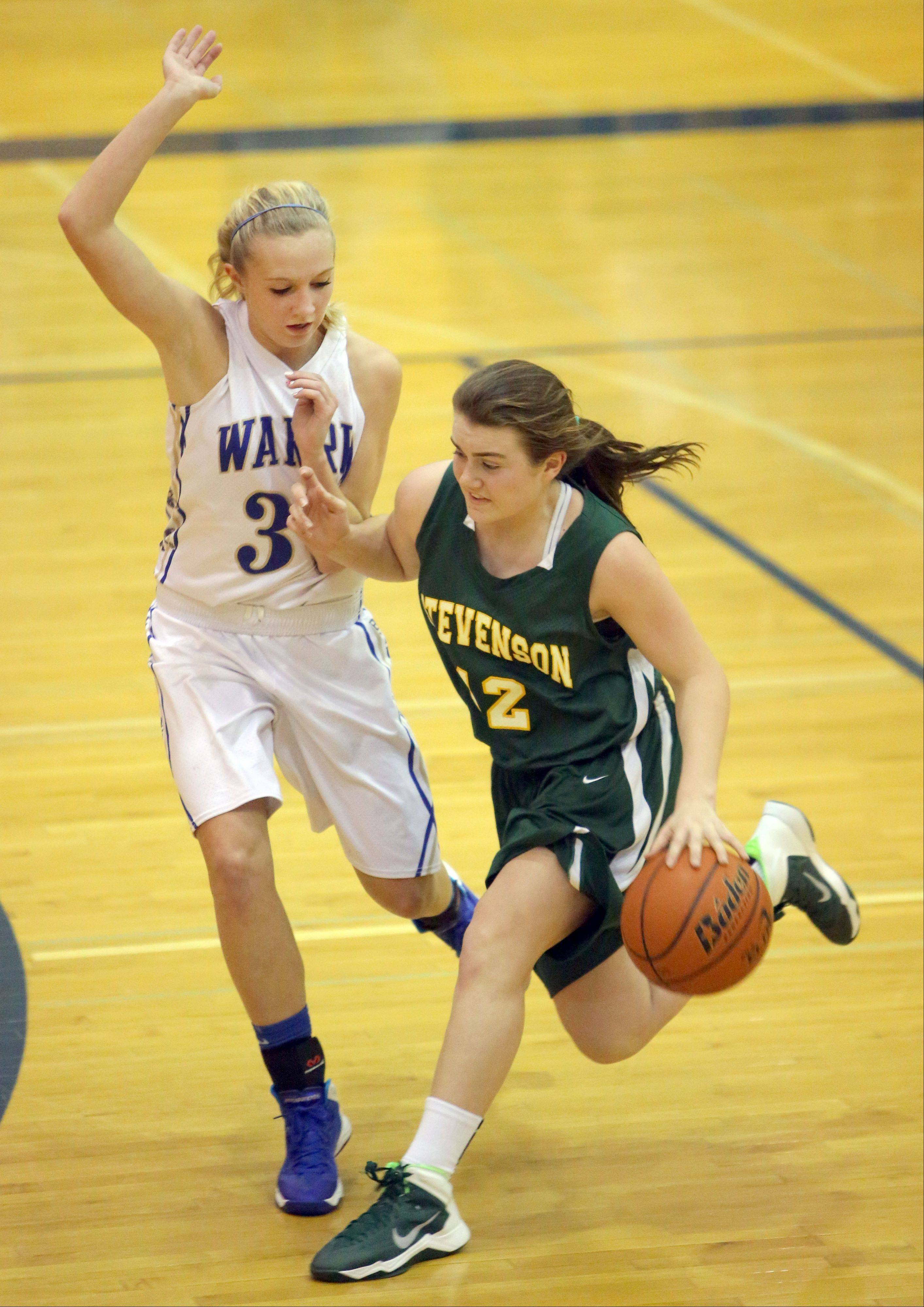 Stevenson's Ashley Richardson, right, drives on Warren's Sammi Jo Nixon on Tuesday night in Gurnee.