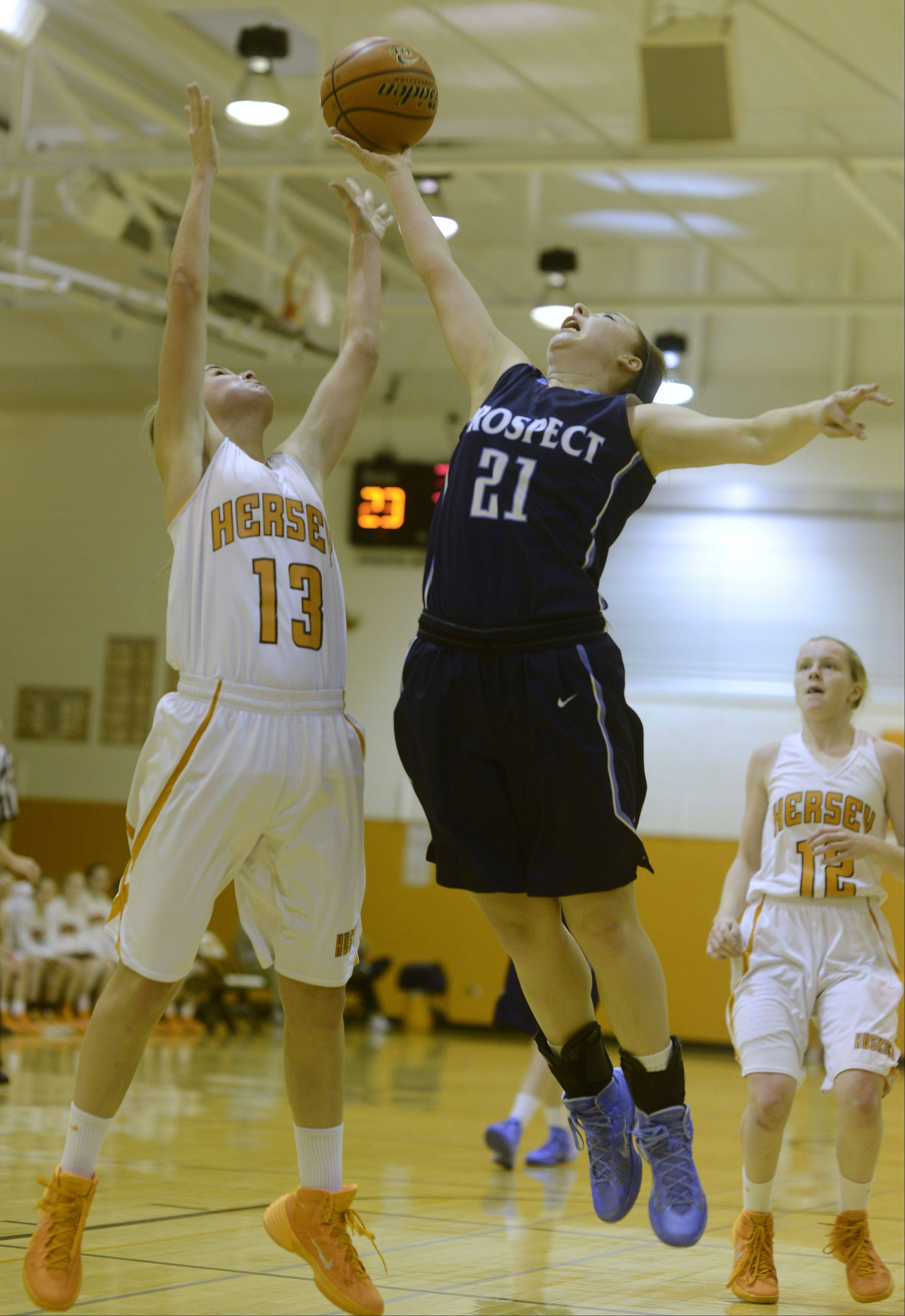 Hersey's Annie Korff, left, and Prospect's Marissa Pacini leap for a rebound during Tuesday's game.