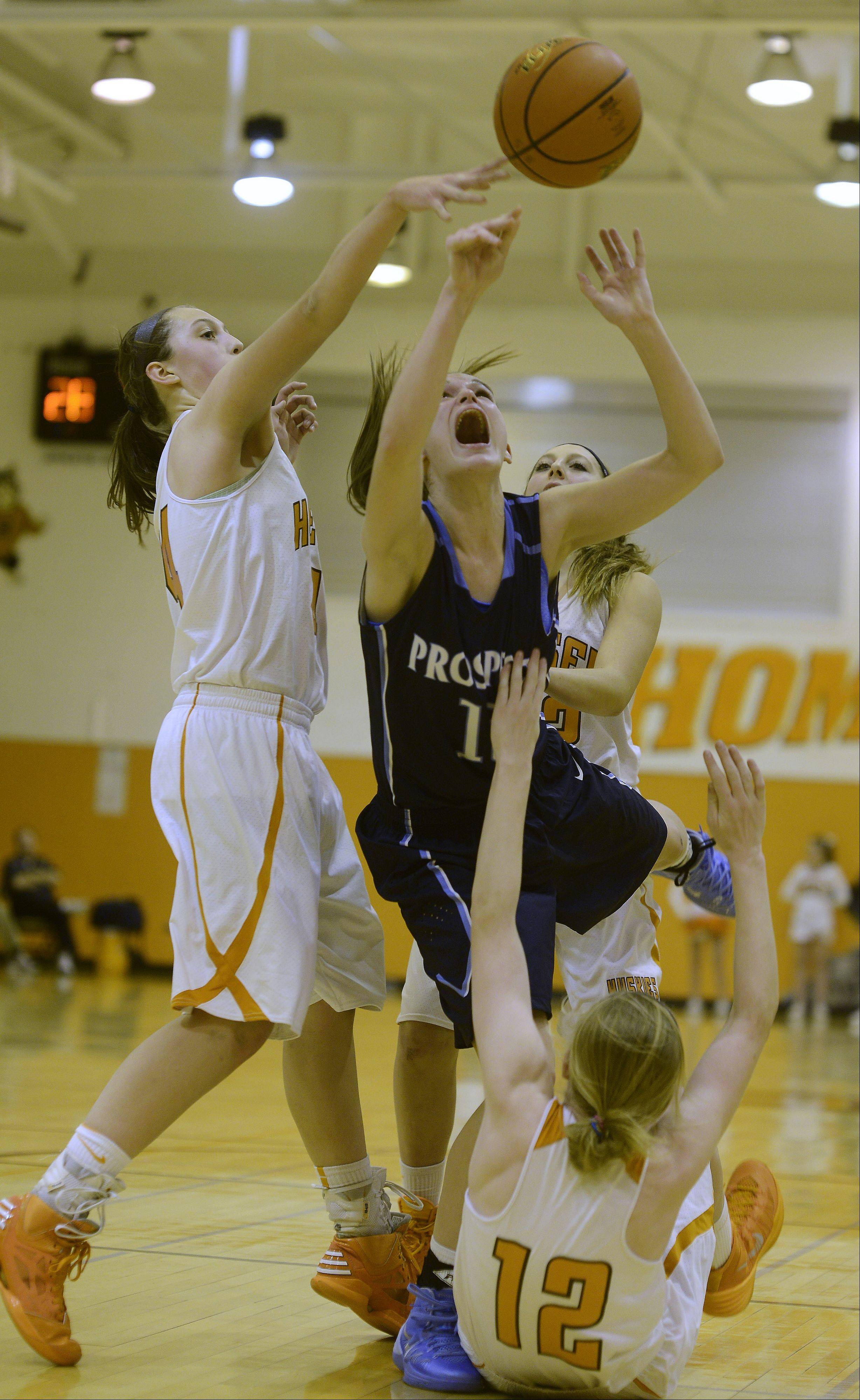 Prospect's Taylor Will makes contact with Hersey's Claire Gritt, front, and Maggie Berigan on a drive to the basket during Tuesday's game.