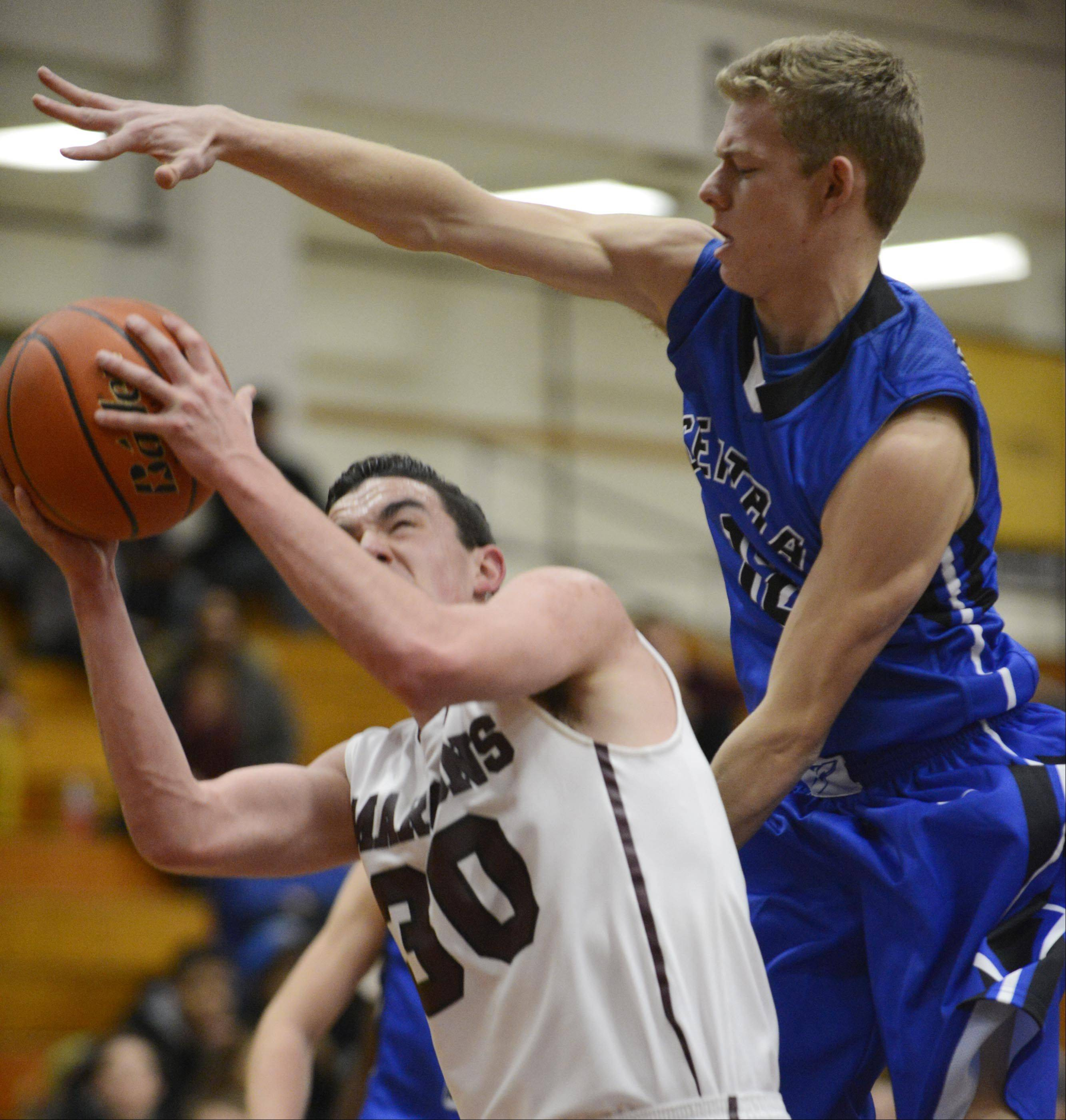 Burlington Central's Stefan Jochum fouls Elgin's Kiko Mari as he tries to block his shot Tuesday in Elgin.