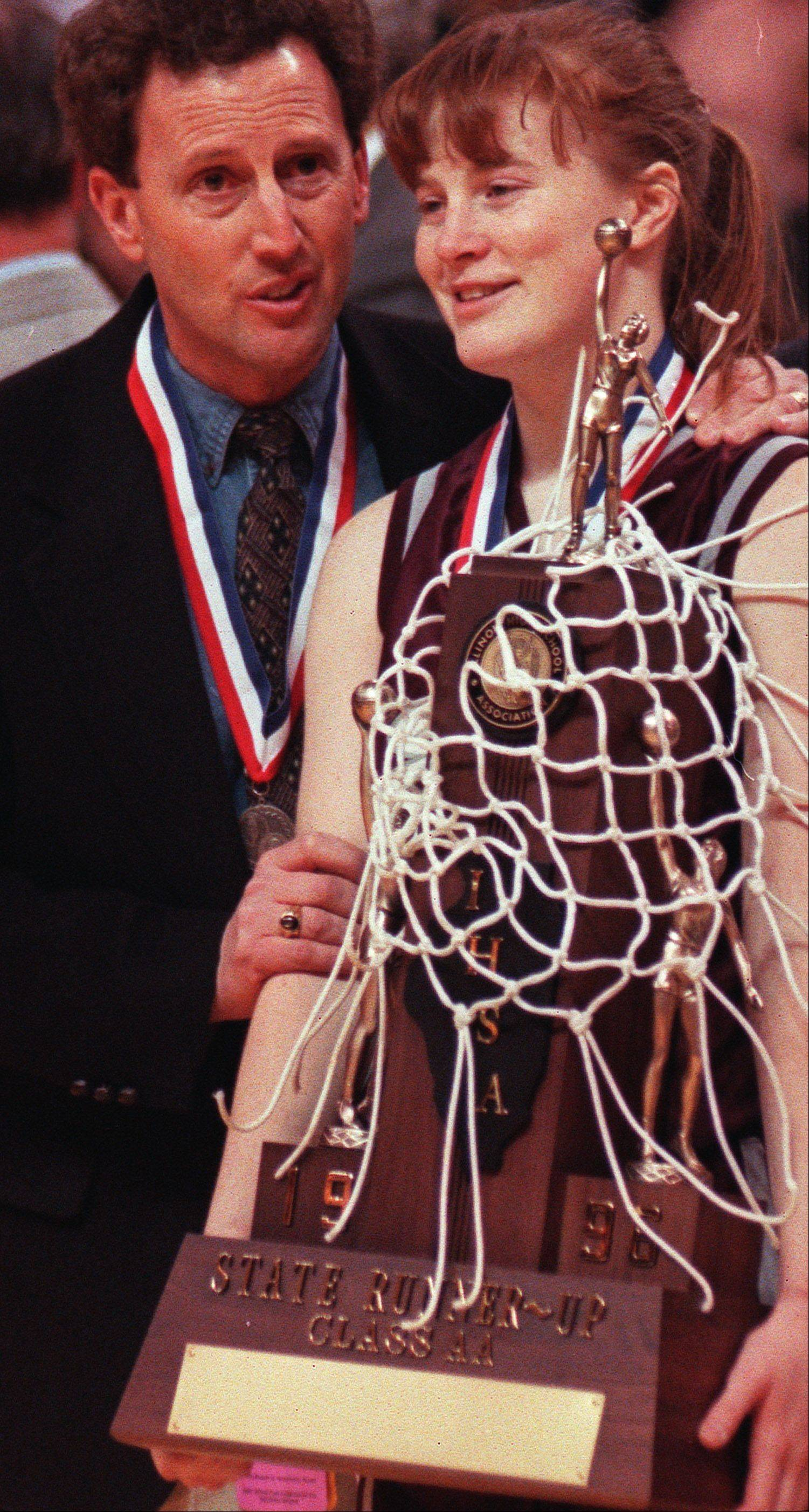 Former Elgin girls basketball coach Lee Turek, left, and Melissa Parker with the 1996 Class AA state runner-up trophy.