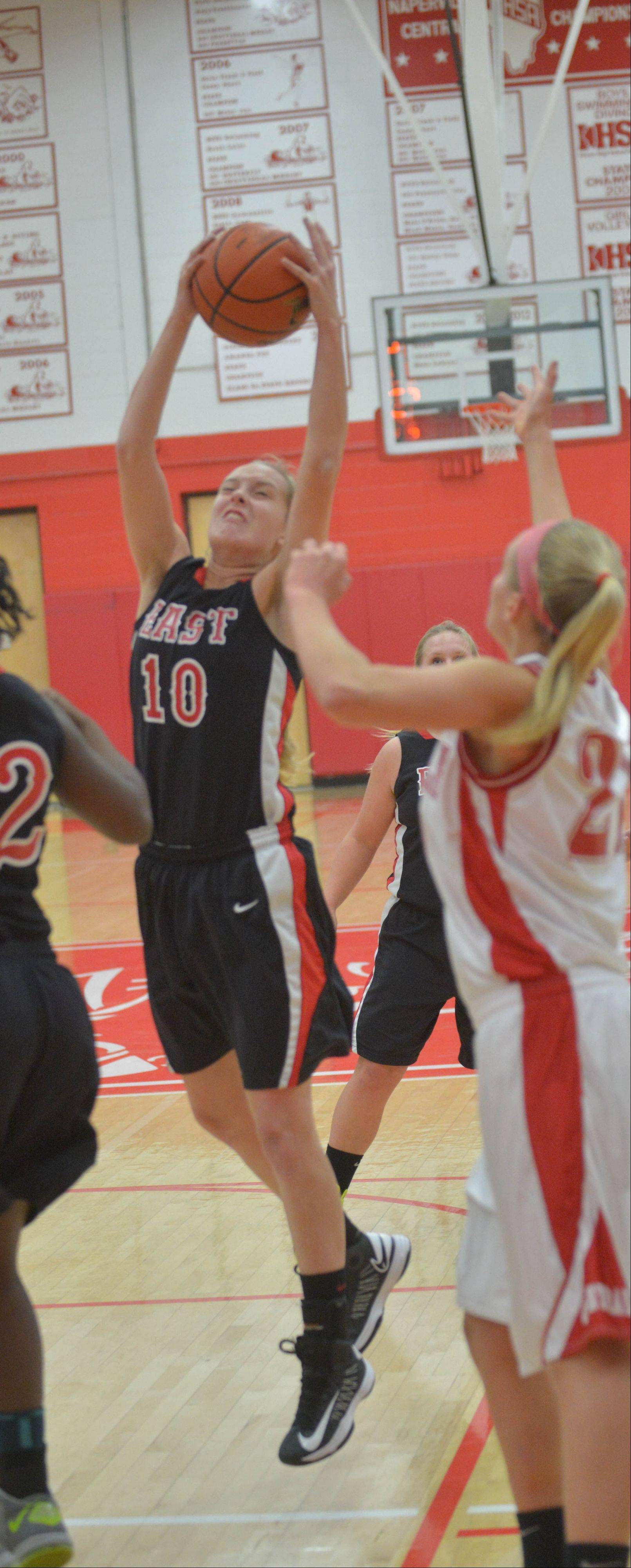 Allison Hansen of Glrenbard East goes up for a rebound during the Glenbard East at Naperville Central girls basketball game Thursday.