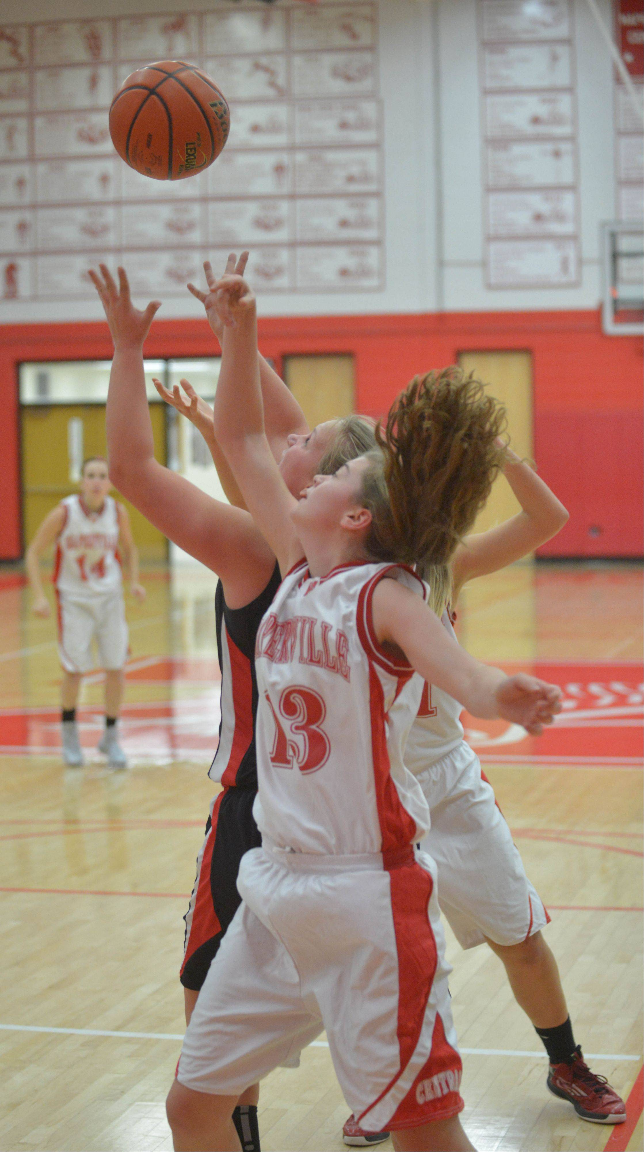 Katie Moran of Naperville Central goes up for a rebound during the Glenbard East at Naperville Central girls basketball game Thursday.