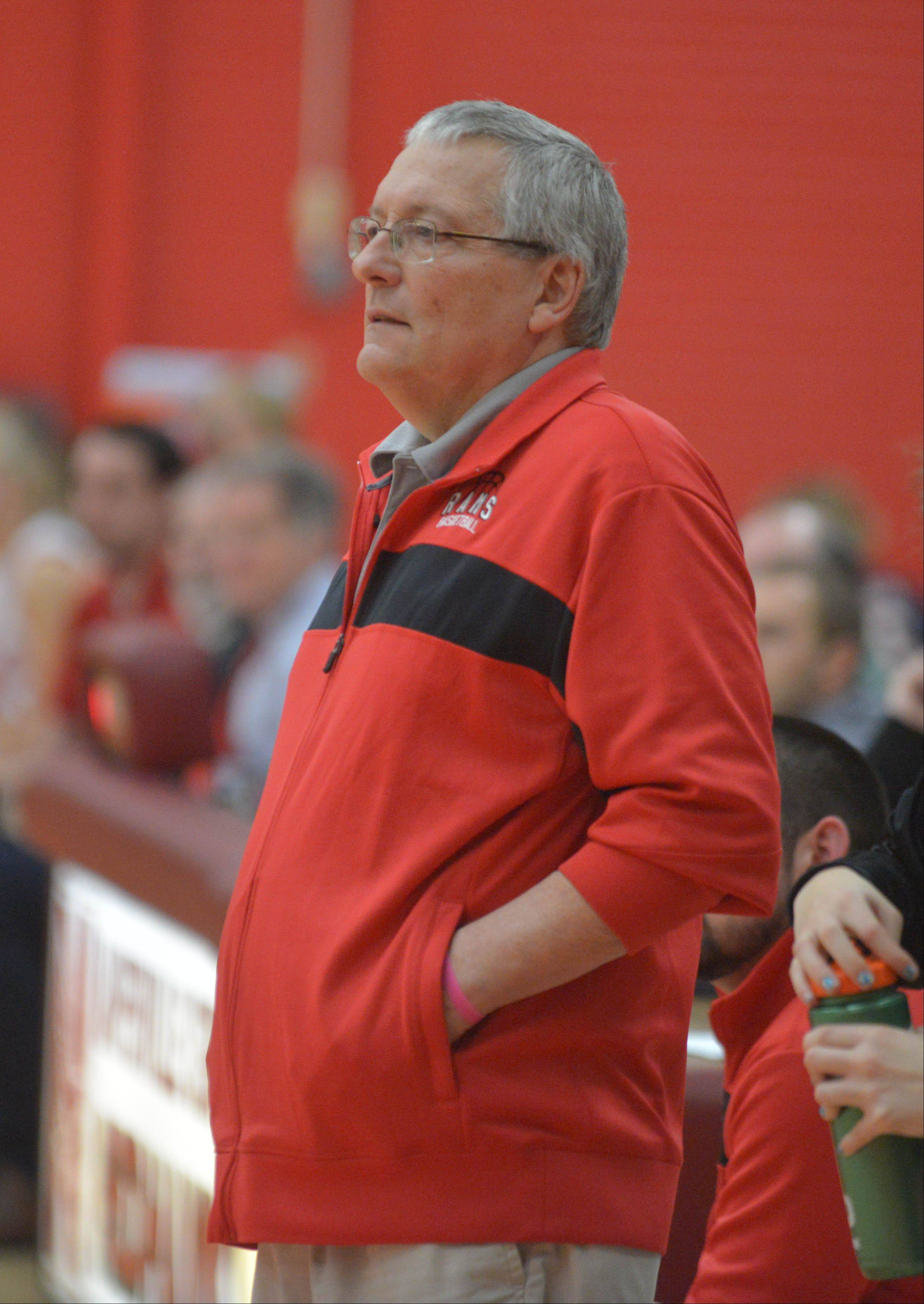 Glenbard East coach Don Finnie works the floor .