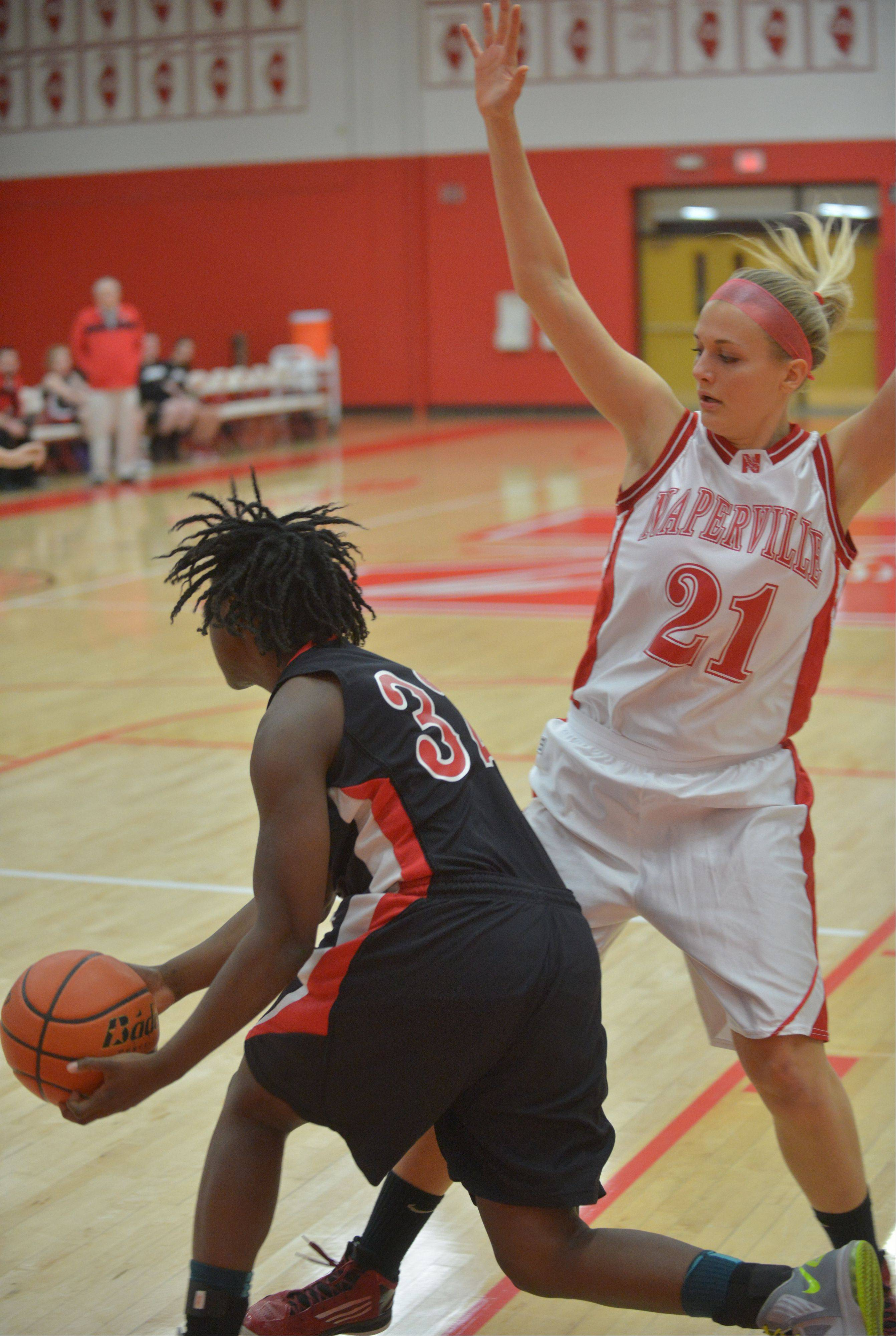Photos from the Glenbard East at Naperville Central girls basketball game Thursday, Dec. 12.
