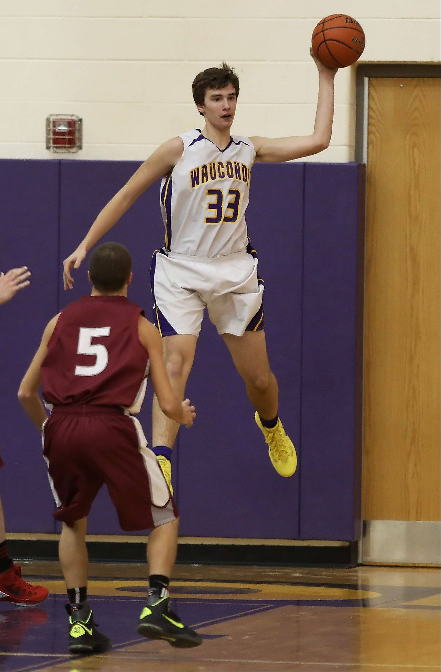 Wauconda forward Ben Carlson saves the ball as it goes out of bounds.