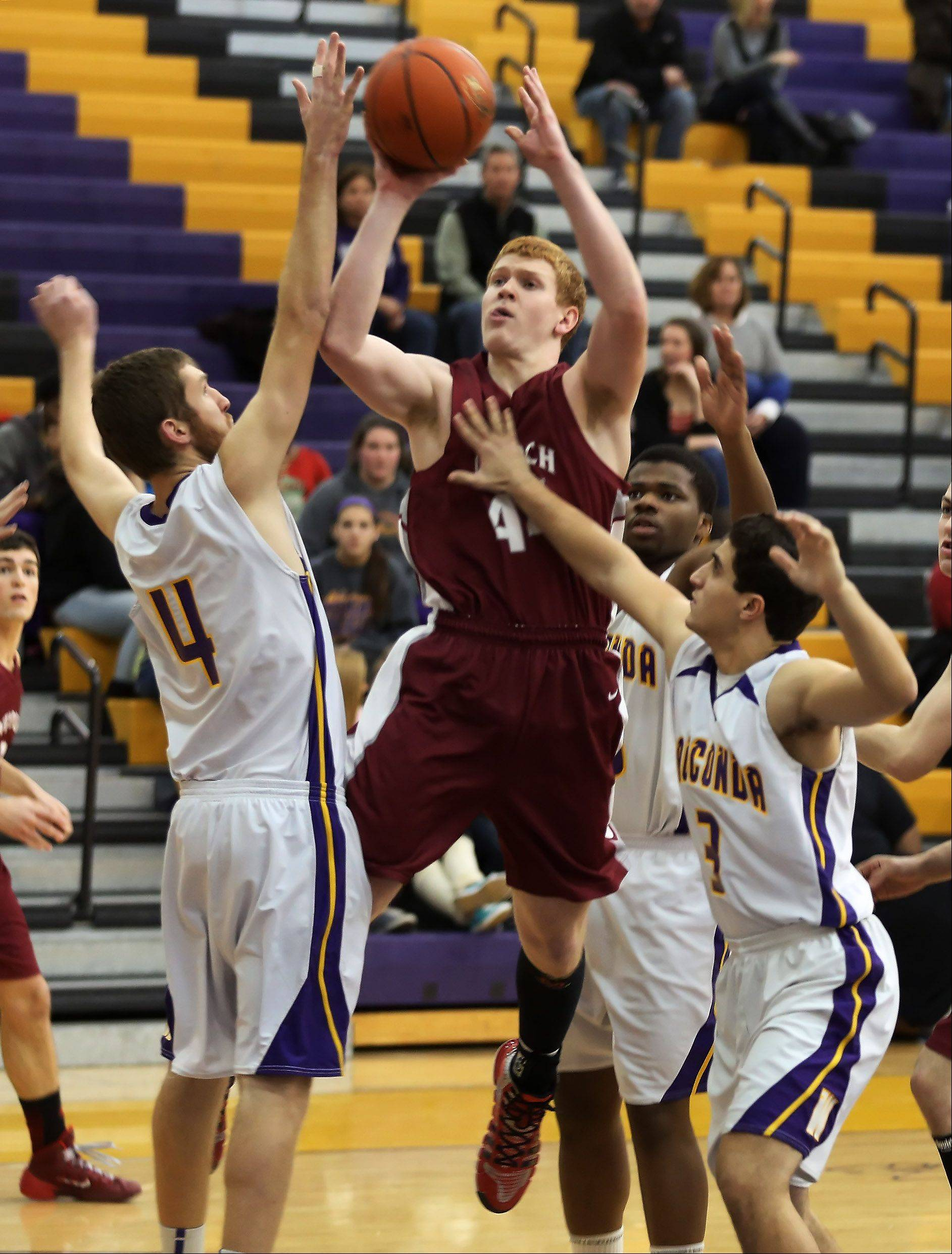 Antioch forward Jack Kovach goes up for a shot over Wauconda players Ricky Sidlowski, left, and Joey Lovelle.