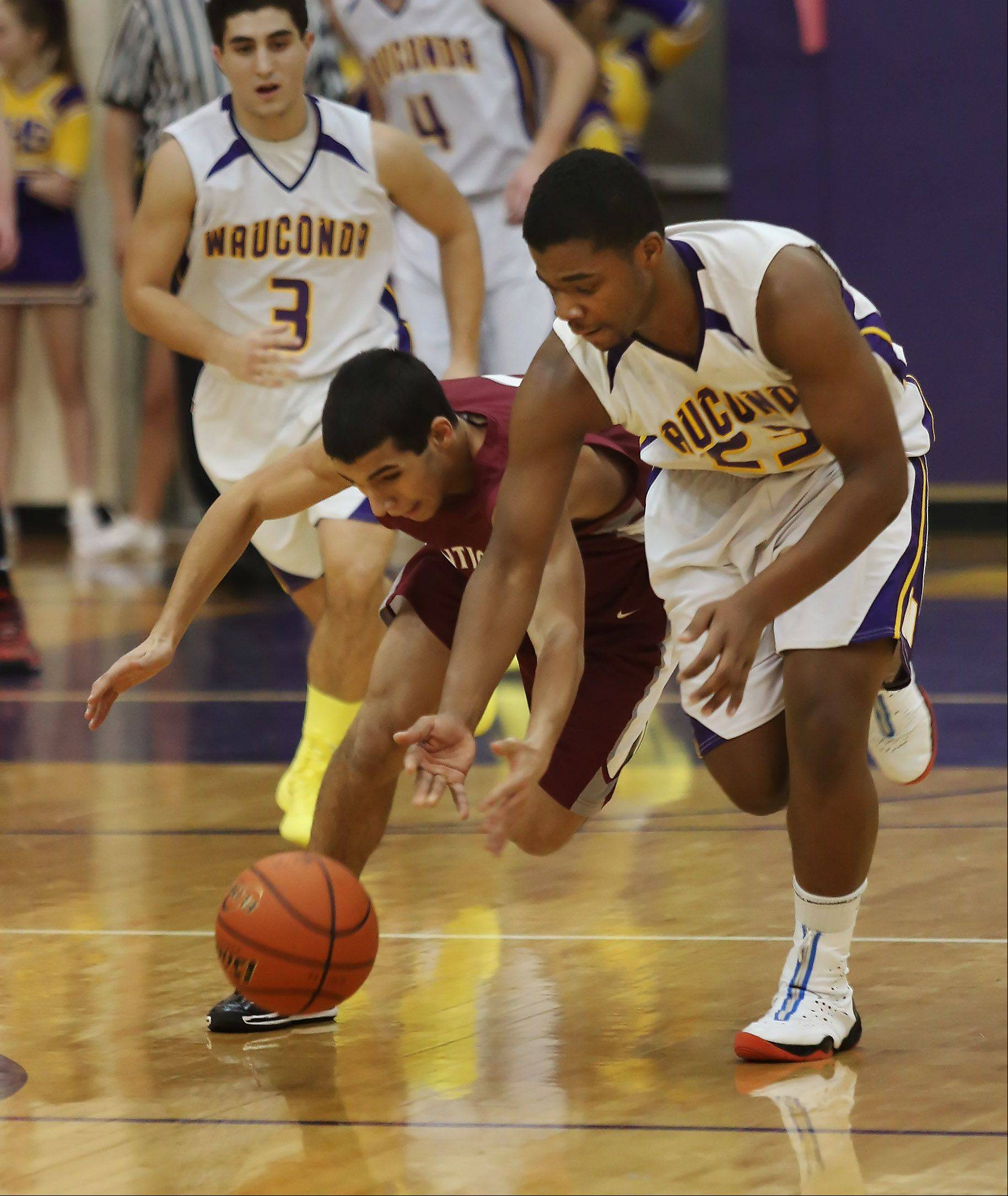 Wauconda forward Dion Head goes after a loose ball from Antioch guard Hamza Abdellatif.