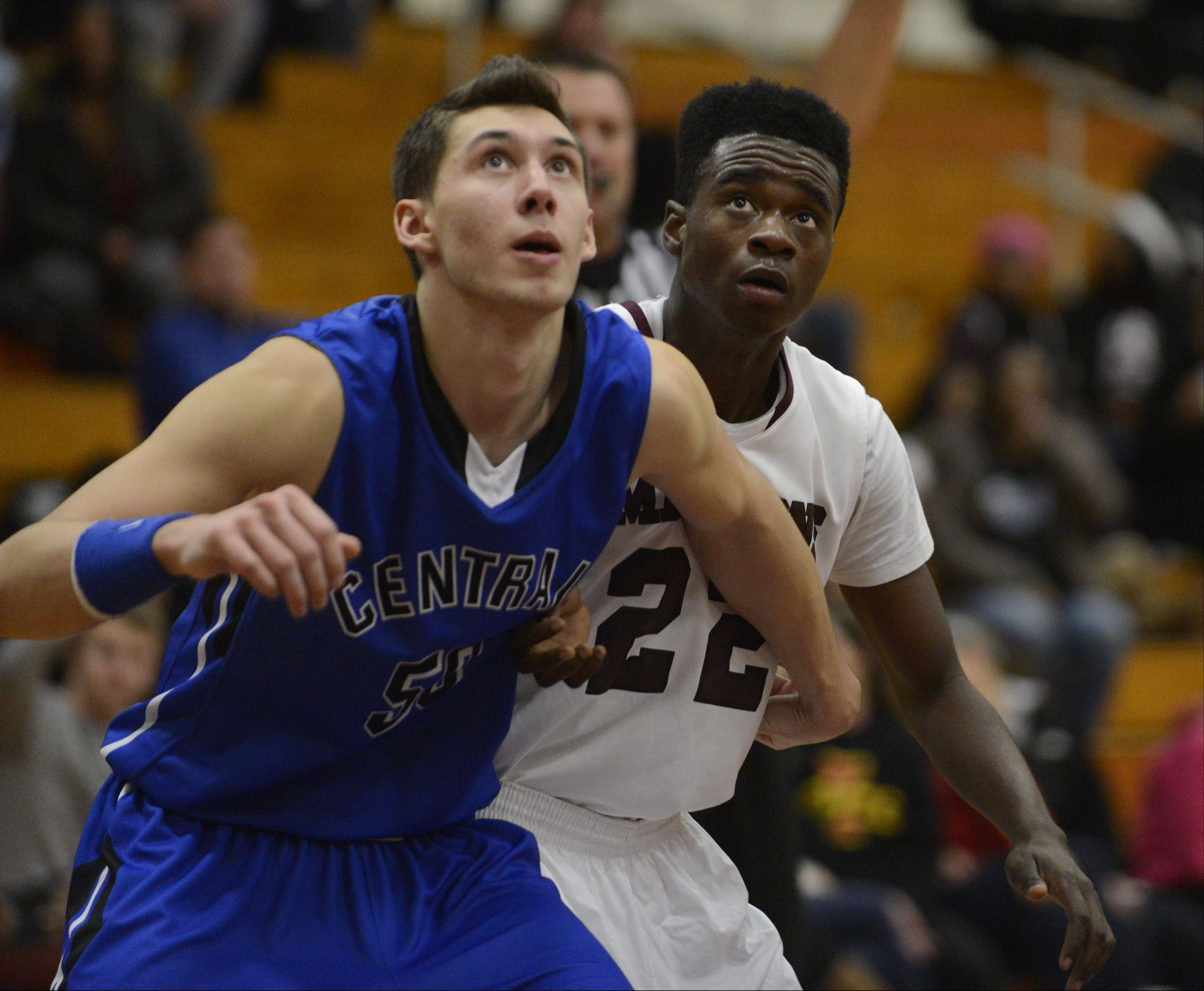 Burlington Central's Duncan Ozburn gets ready for a rebound against Elgin Tuesday night.