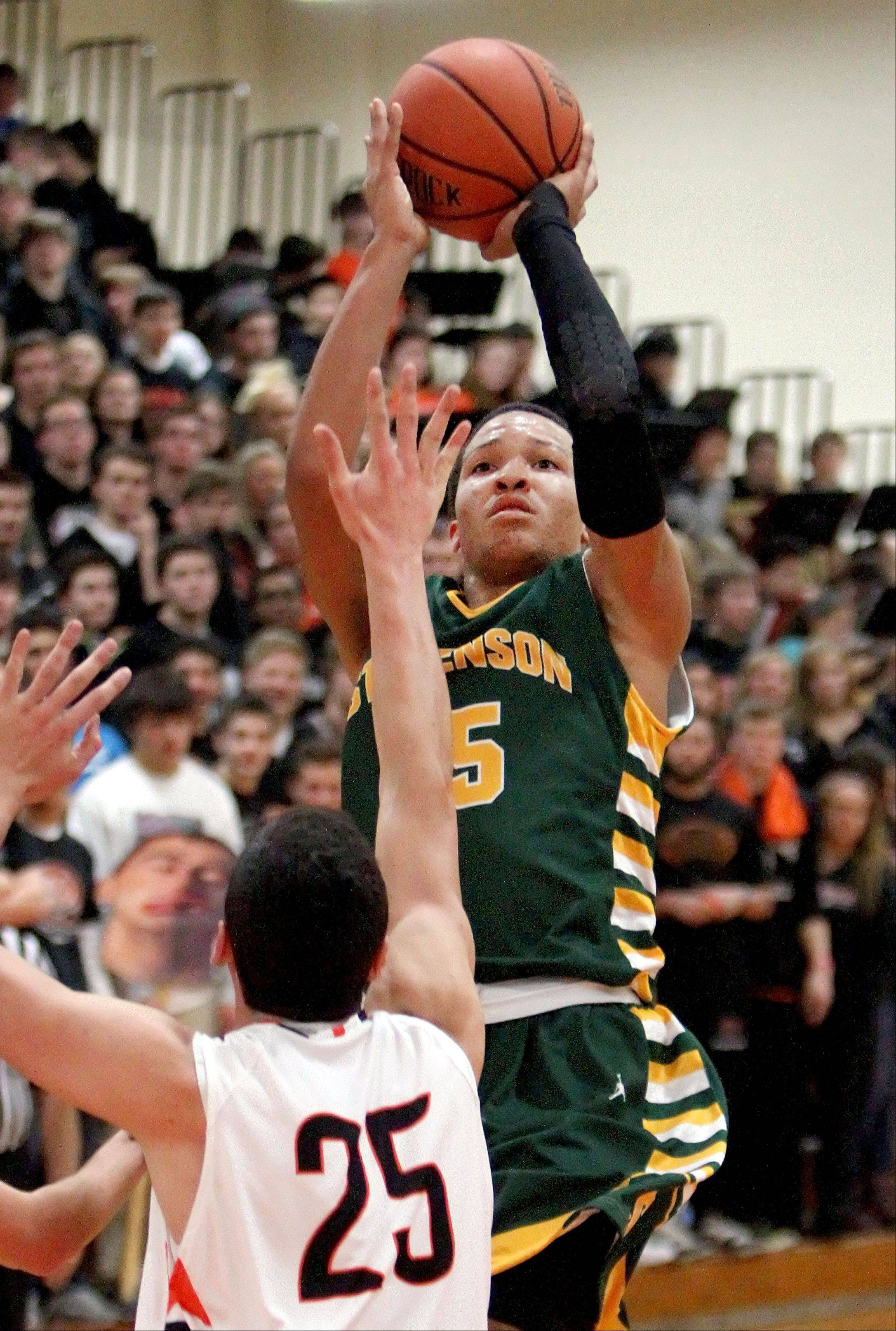 Stevenson's Jaylen Brunson, right, shoots over Libertyville's Johnny Vernasco.