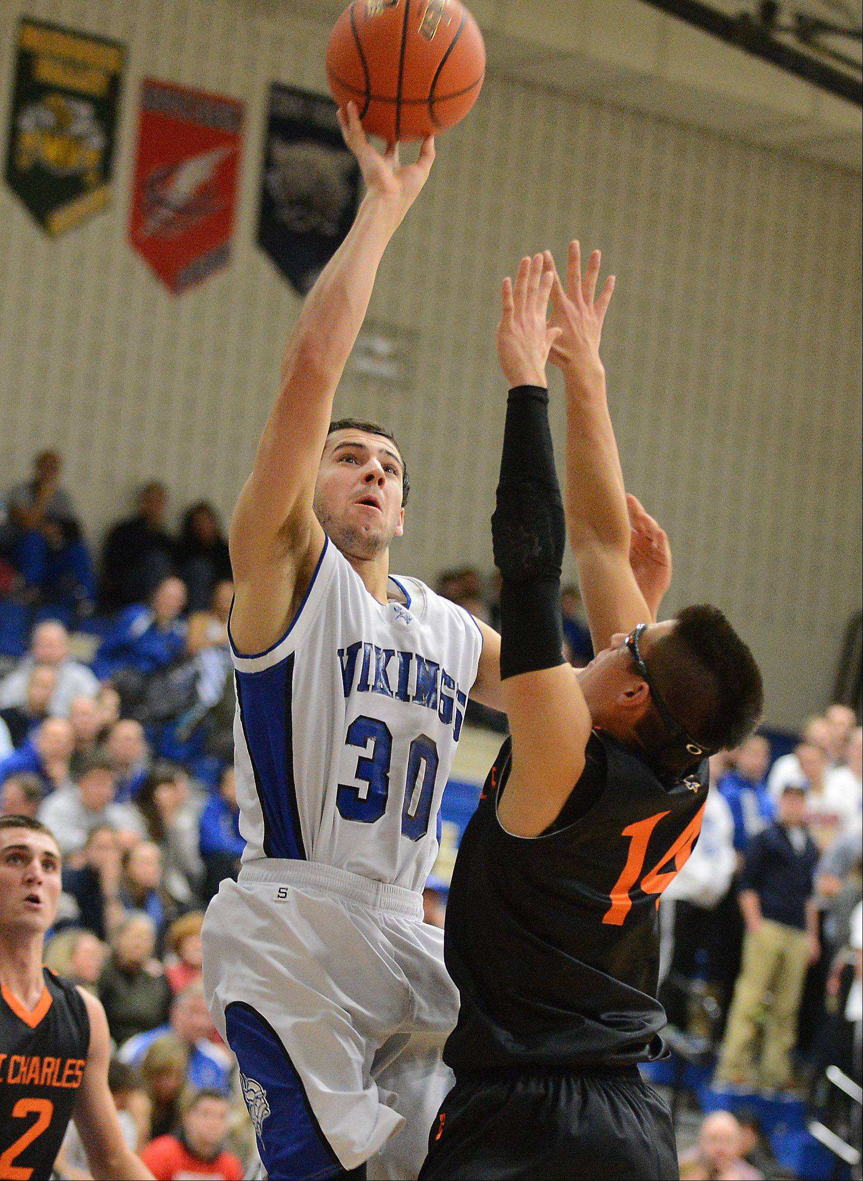 Geneva's Chris Parrilli (30) puts up a one-hander during Friday's game in Geneva.