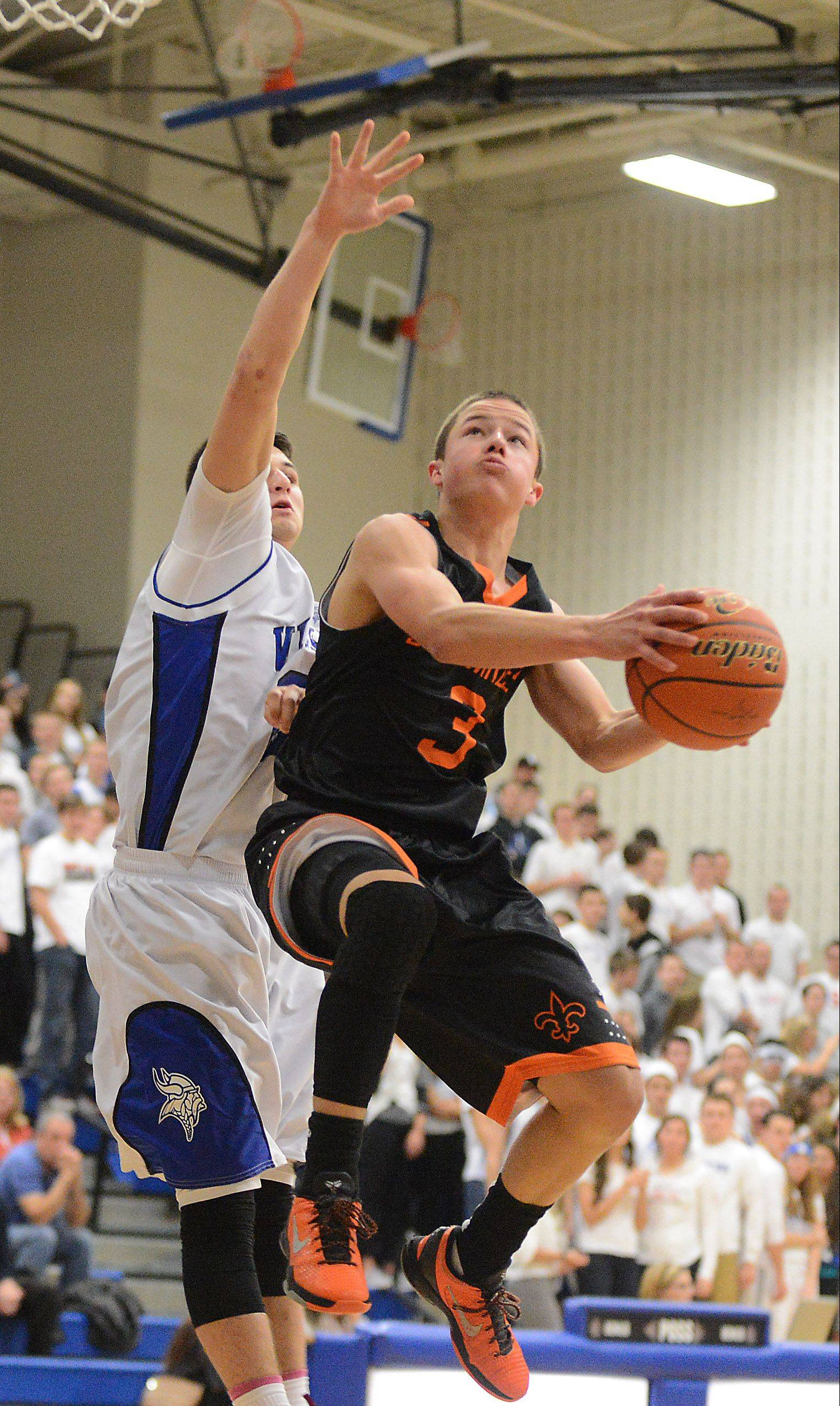 St. Charles East's Cole Gentry drives and scores during Friday's game in Geneva.
