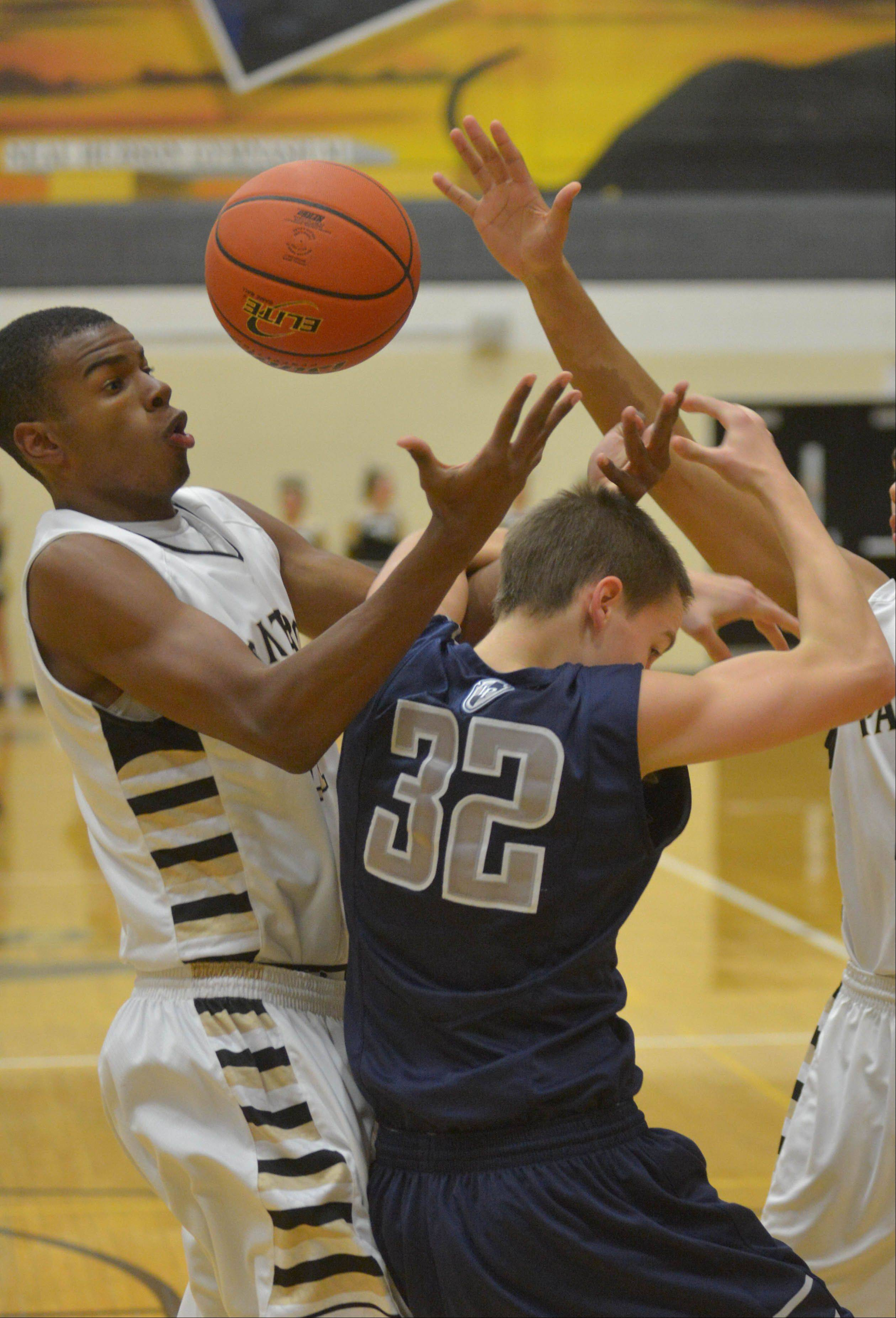 Chip Flanigan of Glenbard North and Connor Vance of Lake Park go for a rebound during the Lake Park at Glenbard North boys basketball game Friday.