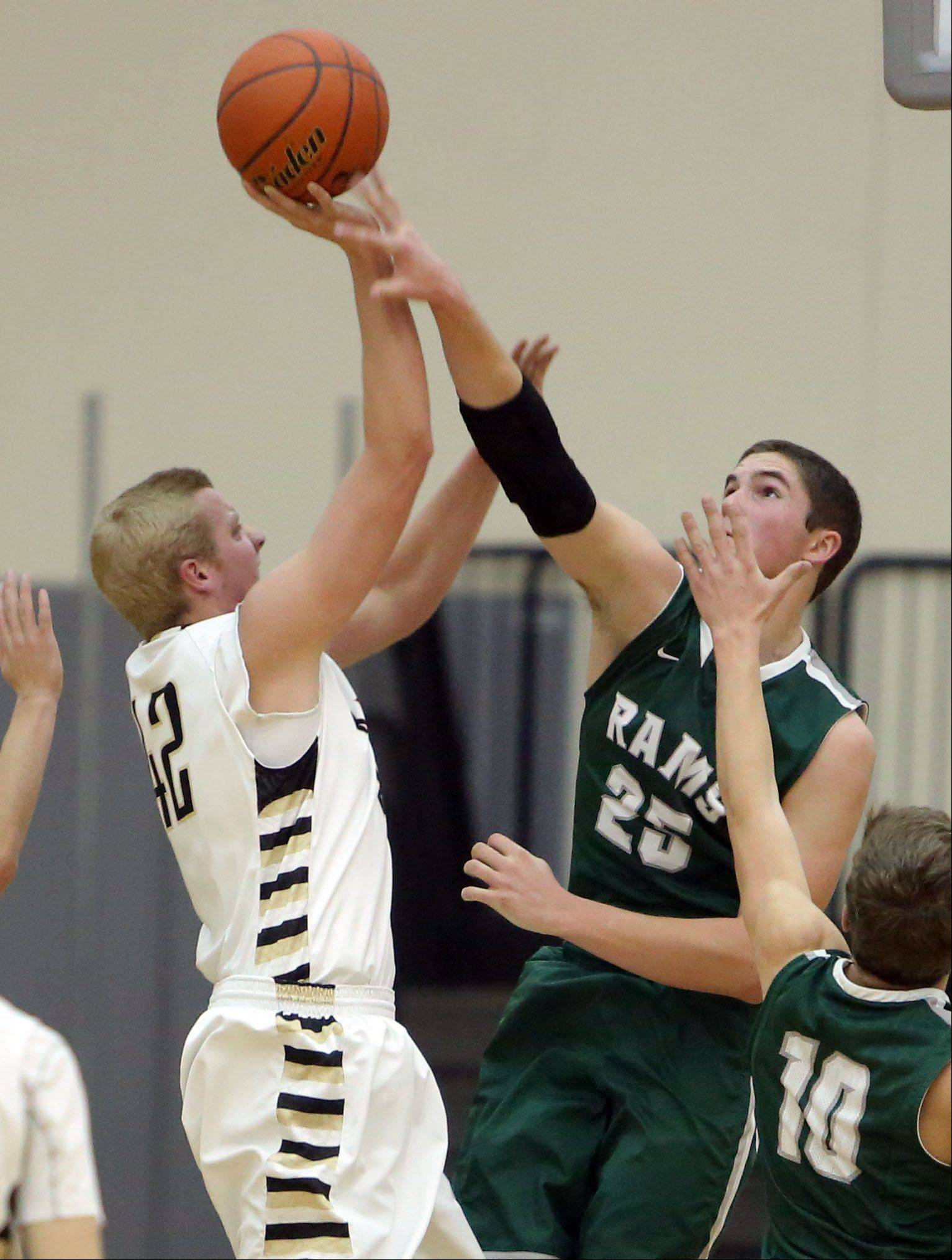 Grayslake Central's Alex Lennartz, right blocks the shot of Grayslake North's Nate Dodge on Friday night at Grayslake North.