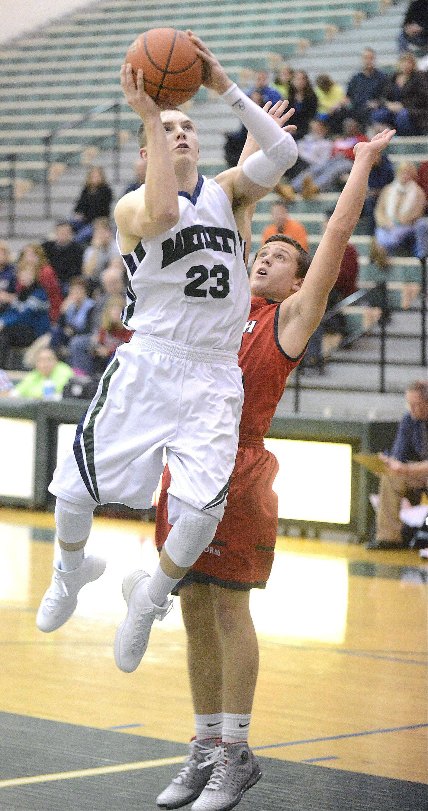 Bartlett's Ryan DiCanio shoots past a block attempt by South Elgin's Matt McClure in the first quarter on Friday in Bartlett.