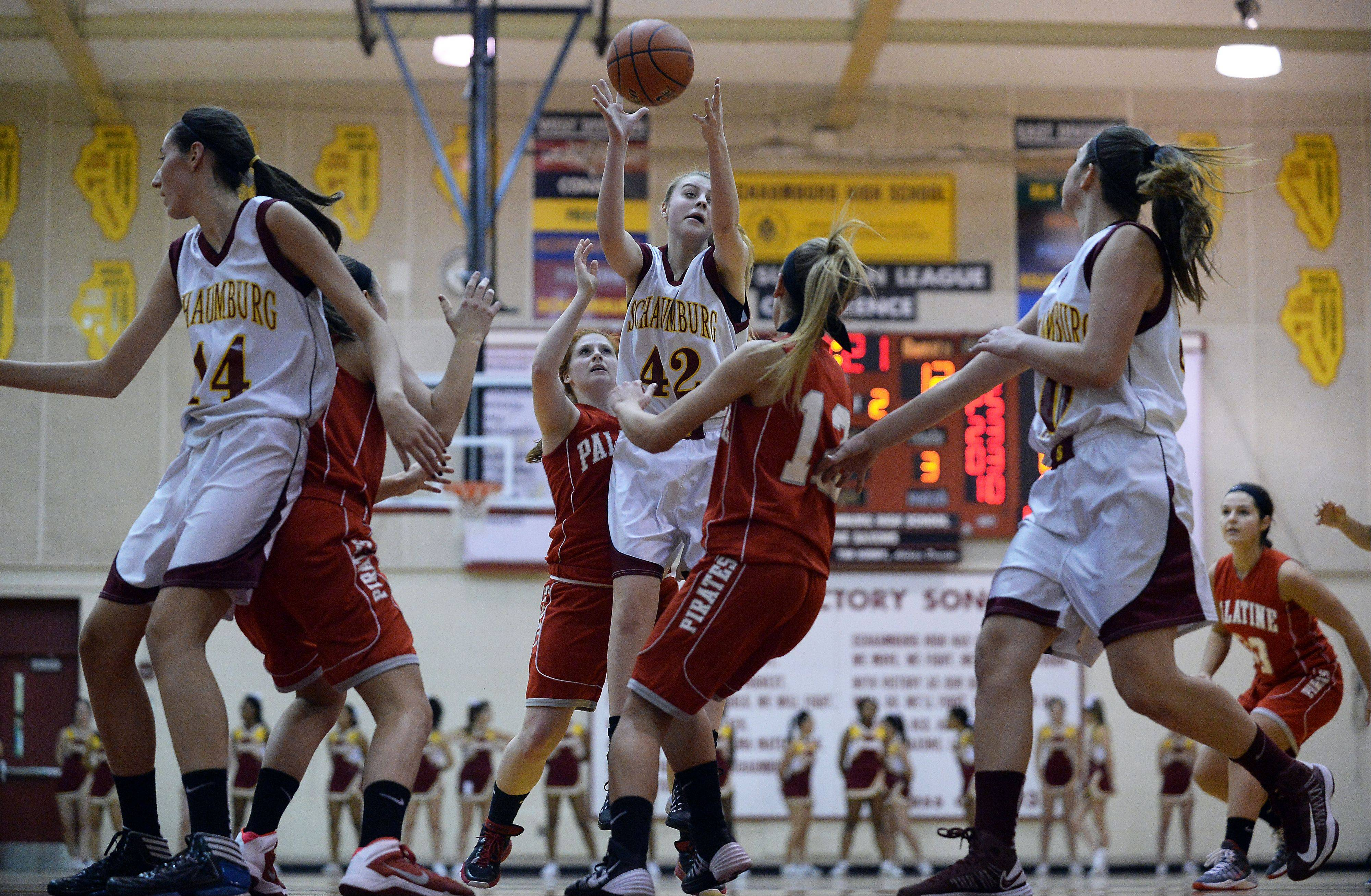 Schaumburg's Mallory Gerber pulls down a rebound in the first half.