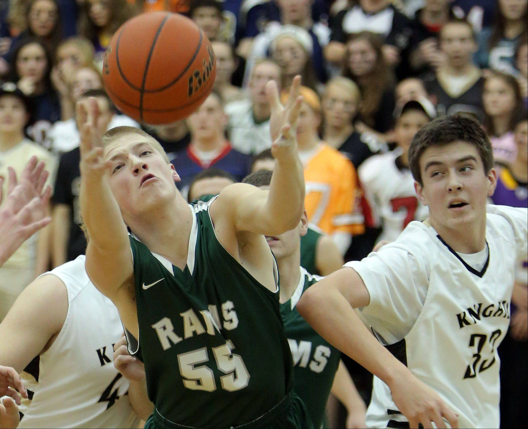 Grayslake Central's Jack Beckman, left, battles for a rebound with Grayslake North's Aiden Einloth.