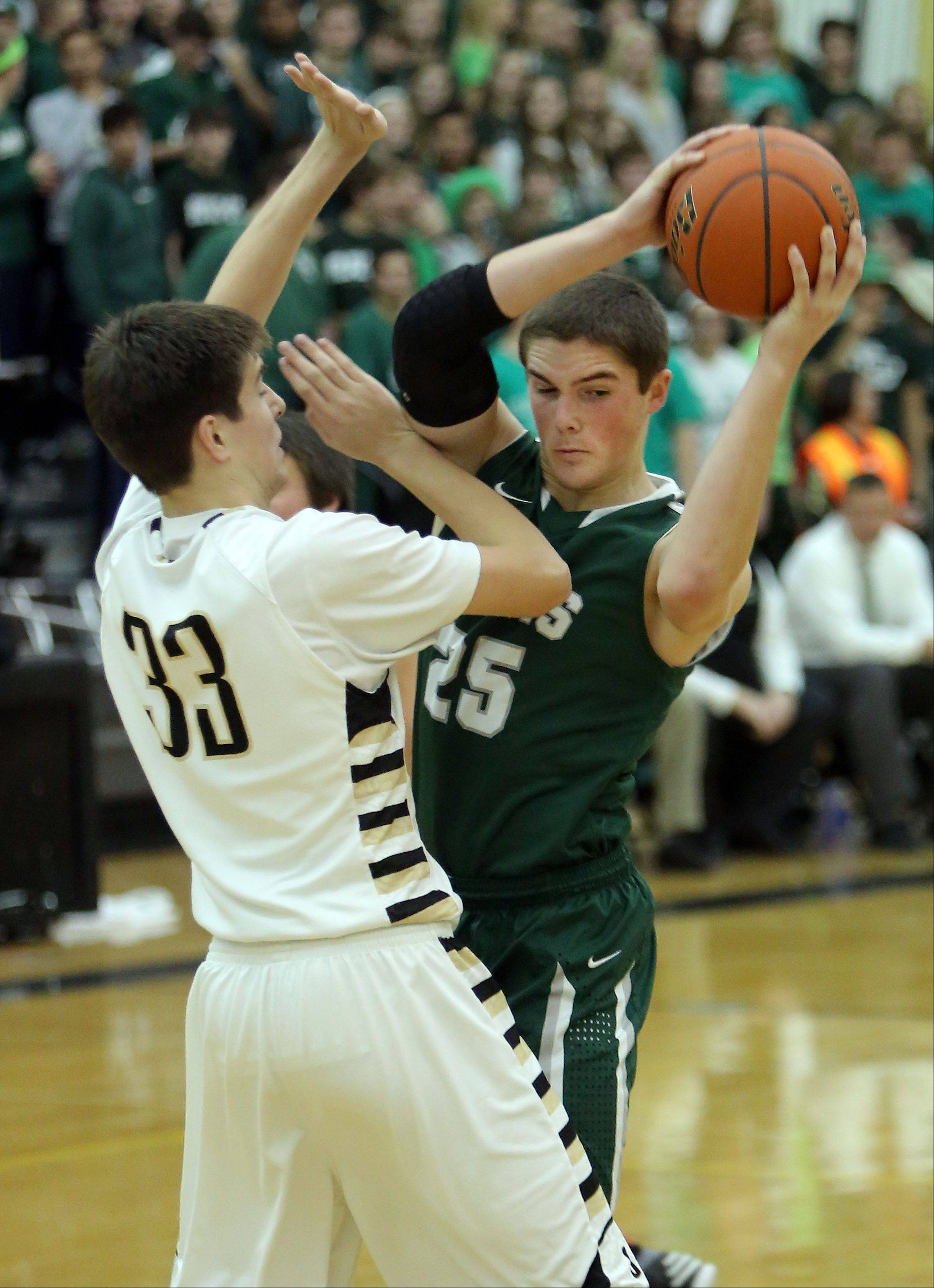 Grayslake North's Aiden Einloth, left, and Grayslake Central's Alex Lennartz battle for a rebound.