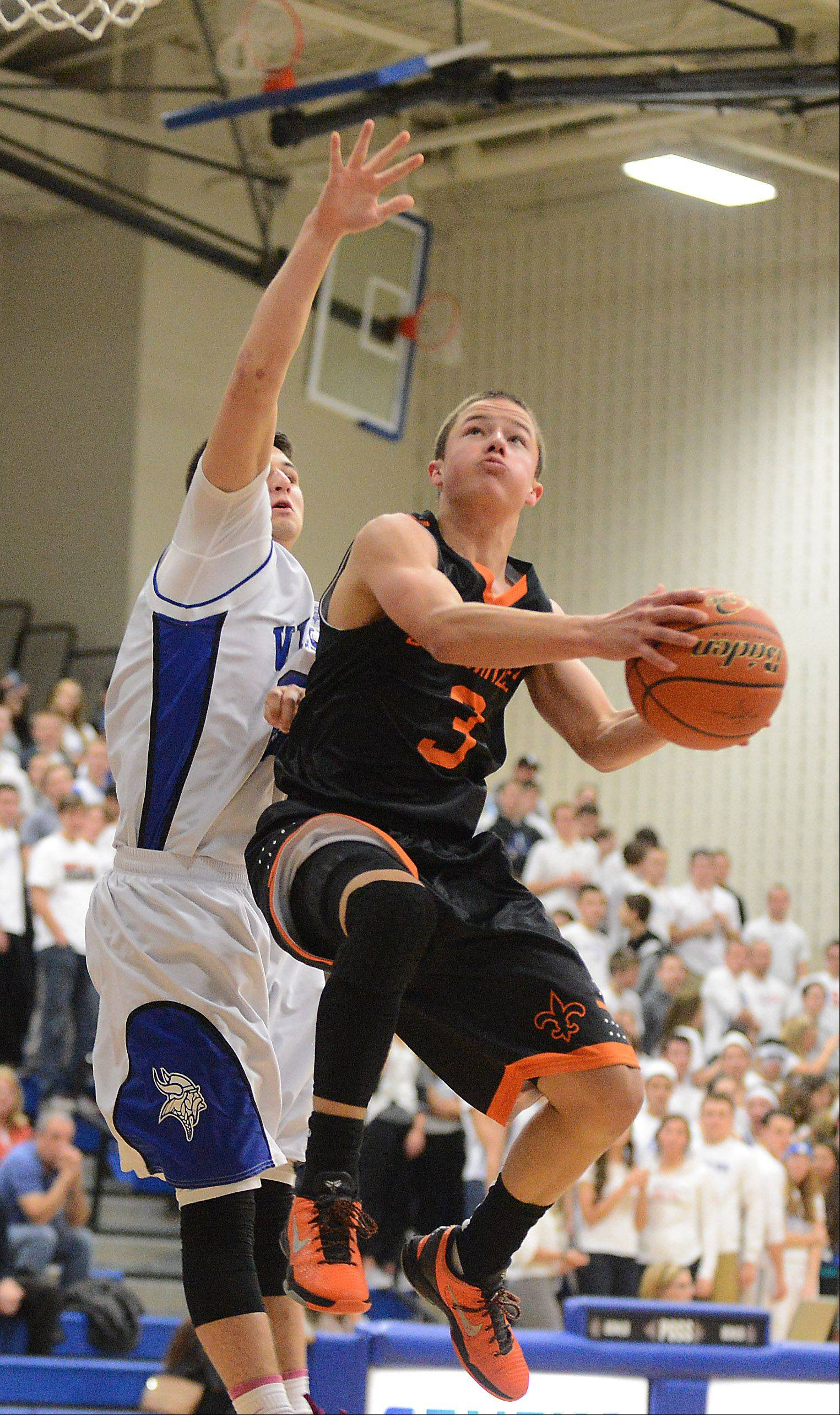 St. Charles East's Cole Gentry drives and scores.