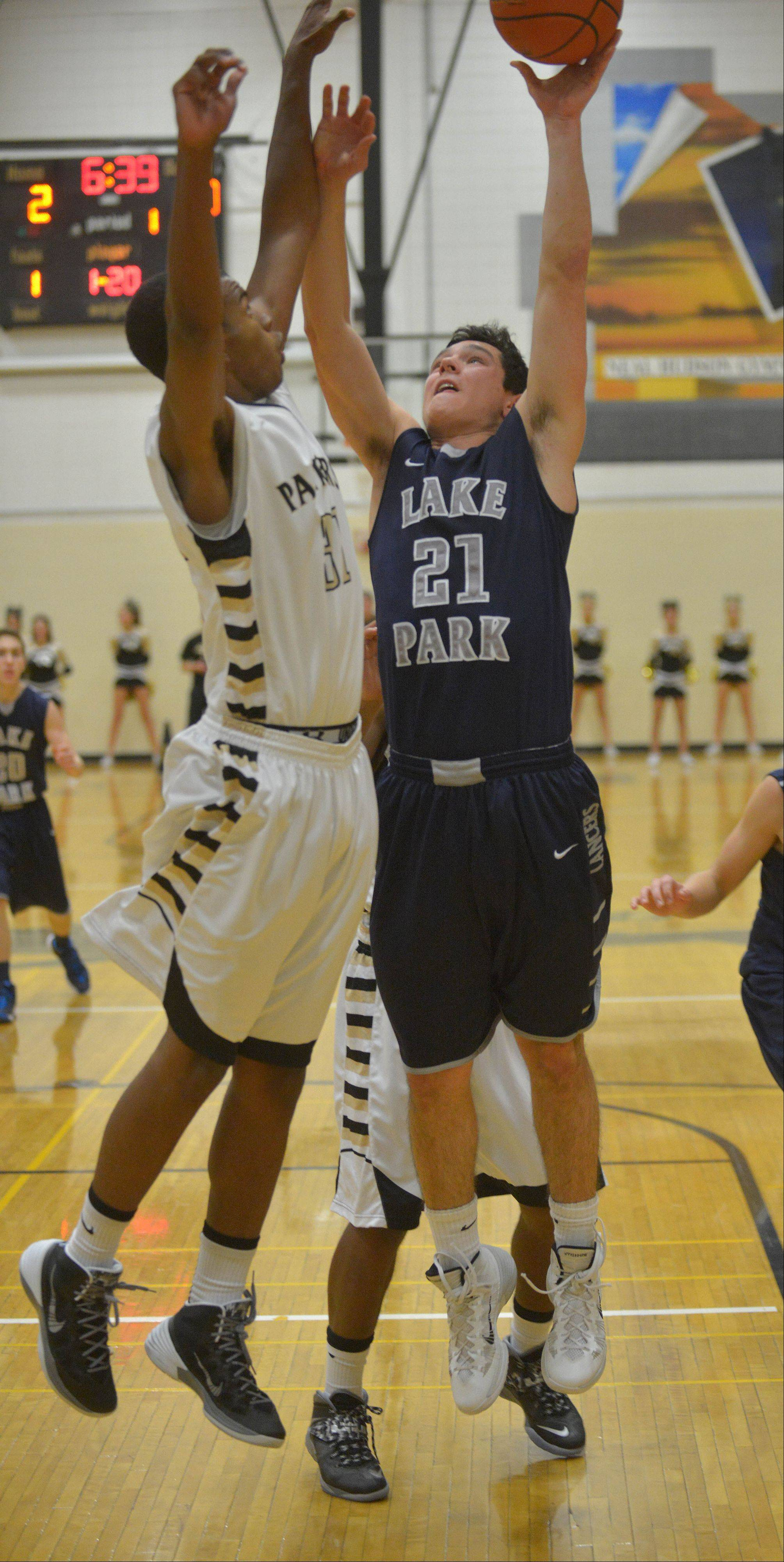 Chip Flanigan of Glenbard North and Michael Karas of Lake Park go for a rebound.