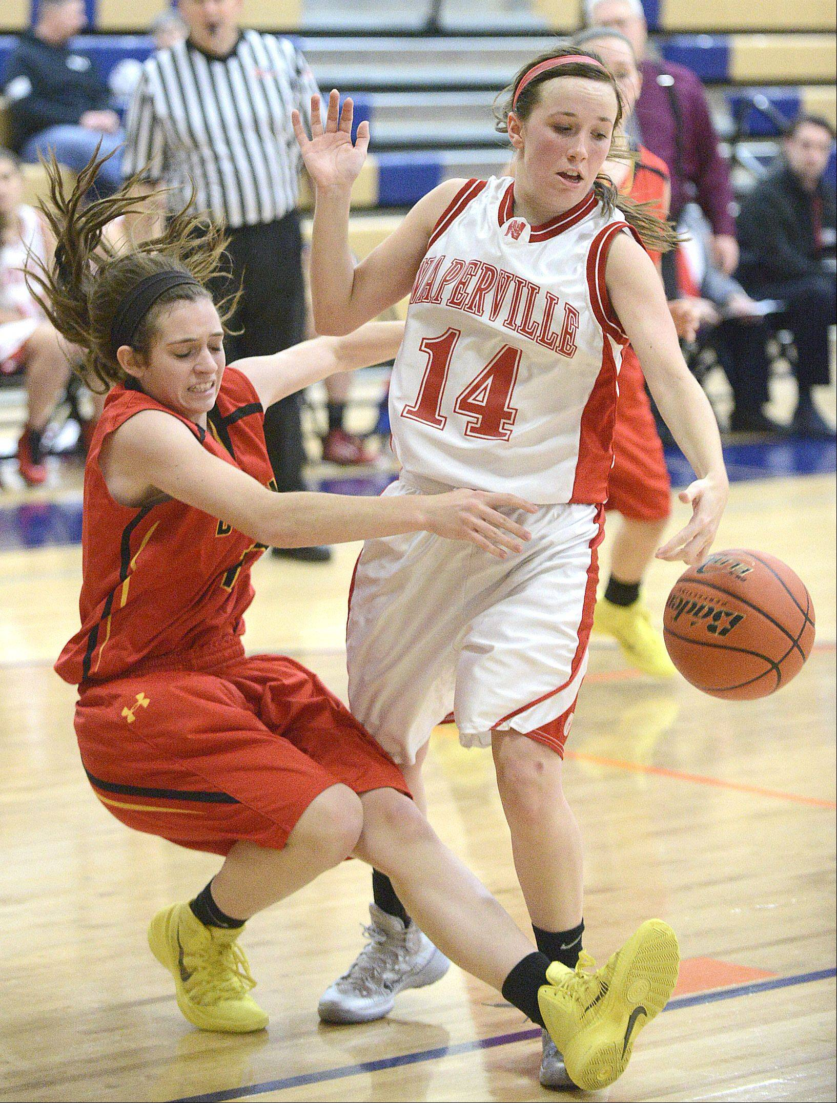 Batavia's Mackenzie Foster falls to the ground during a pass around Naperville Central's Emily Kraft in the third quarter on Saturday.