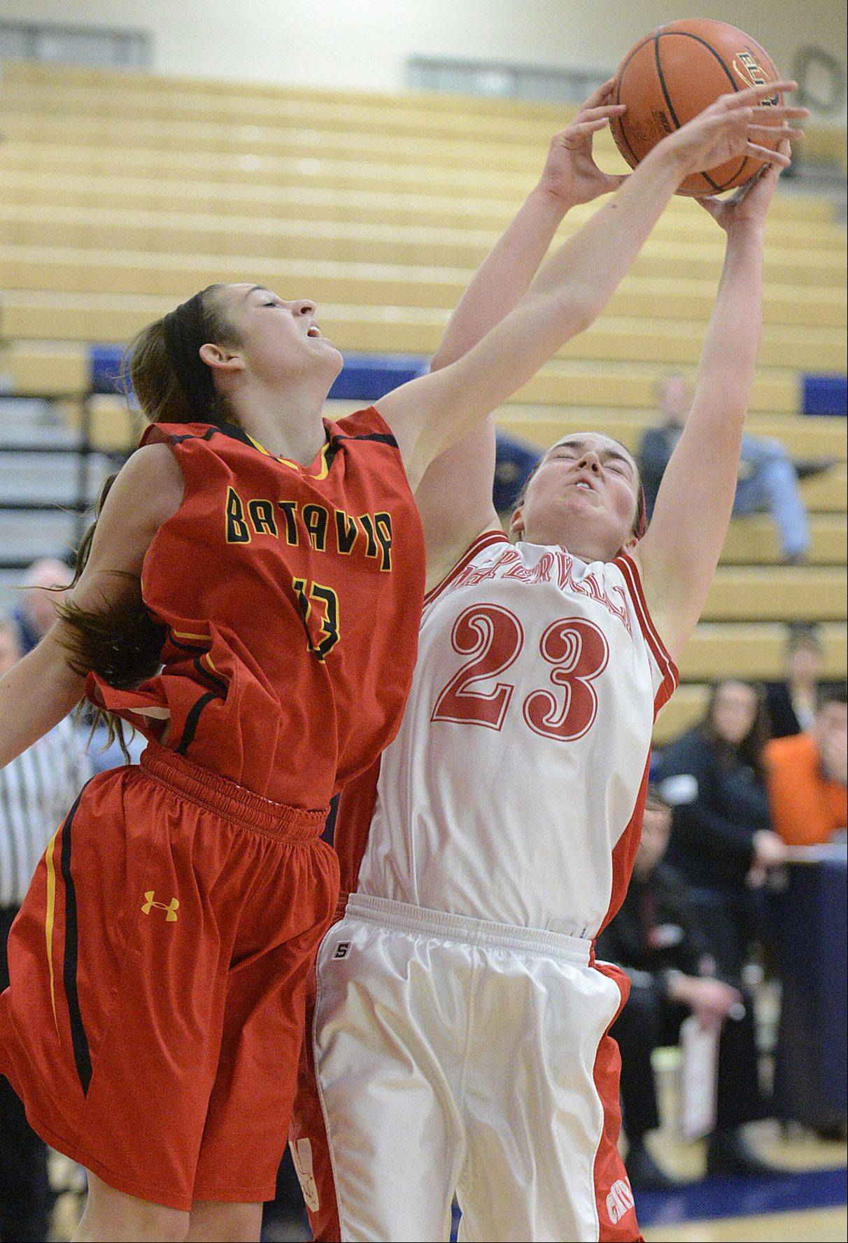 Batavia's Mackenzie Foster and Naperville Central's Lisa Tassi fight for a Bulldogs rebound in the second quarter.