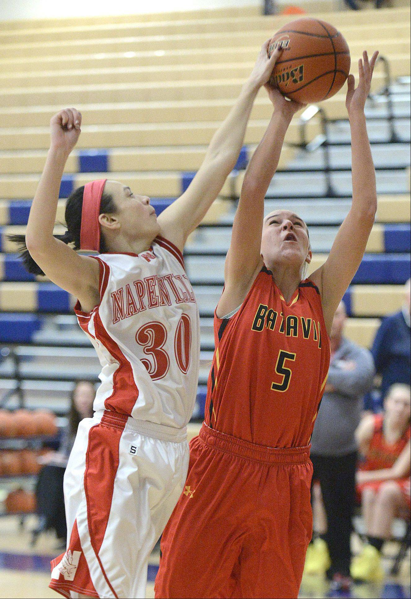 Naperville Central's Shannon Ryan knocks the ball from the hands of Batavia's Liza Fruendt, denying her a basket in the third quarter.