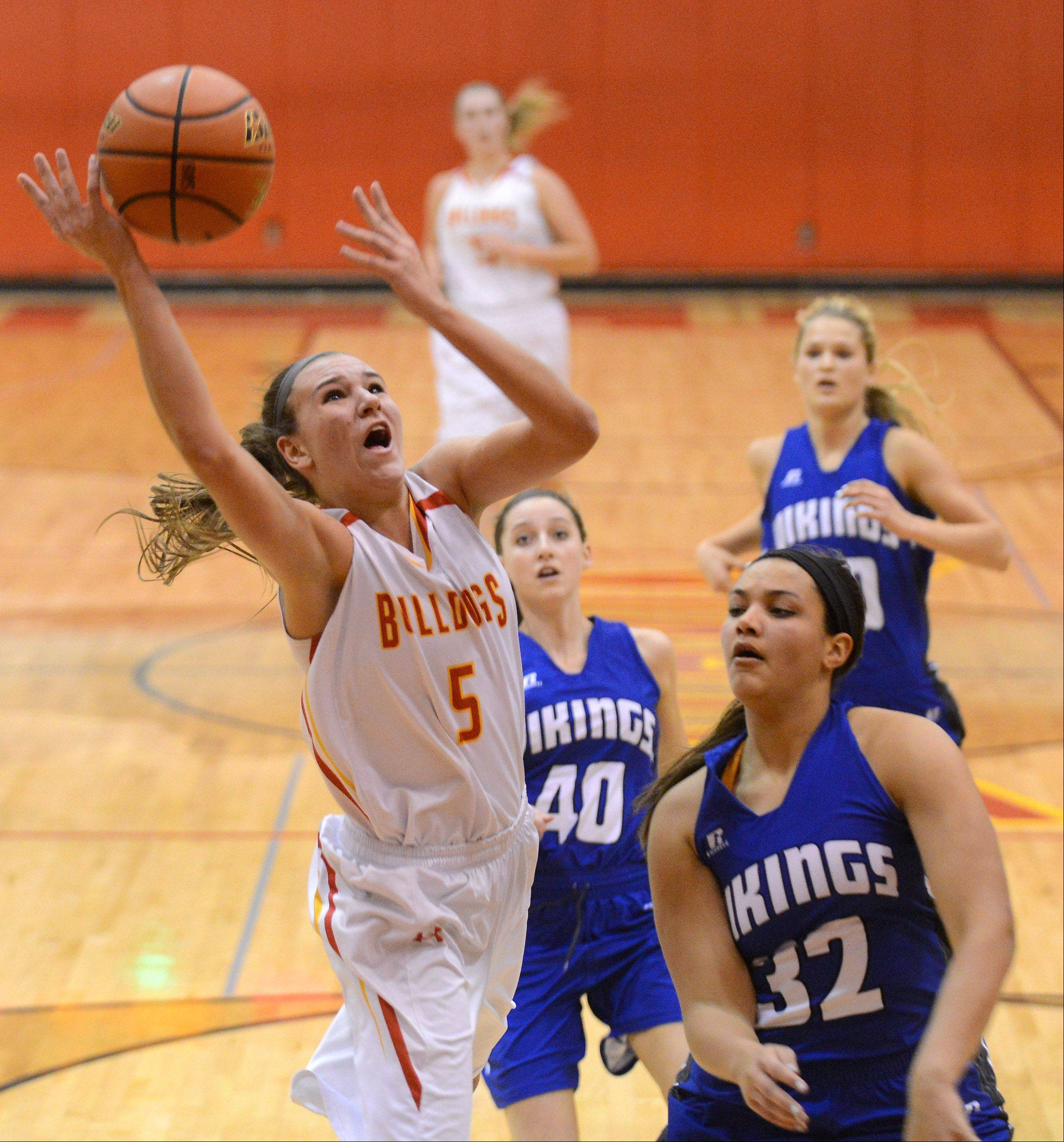 Batavia's Liza Fruendt (5) shoots and scores in front of Geneva's Sidney Santos (32) during Friday's game in Batavia.