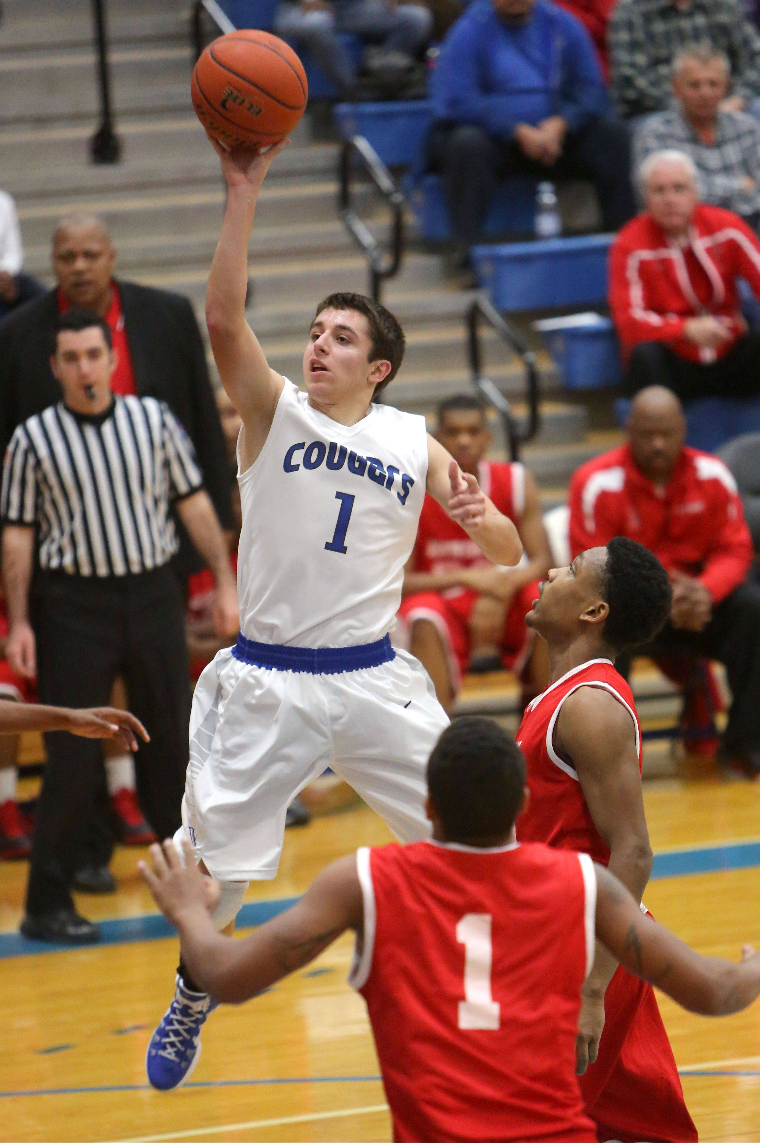 Vernon Hills' Robby Nardini drives on North Chicago's Arnold Shead and Jamero Shelton on Tuesday night in Vernon Hills.