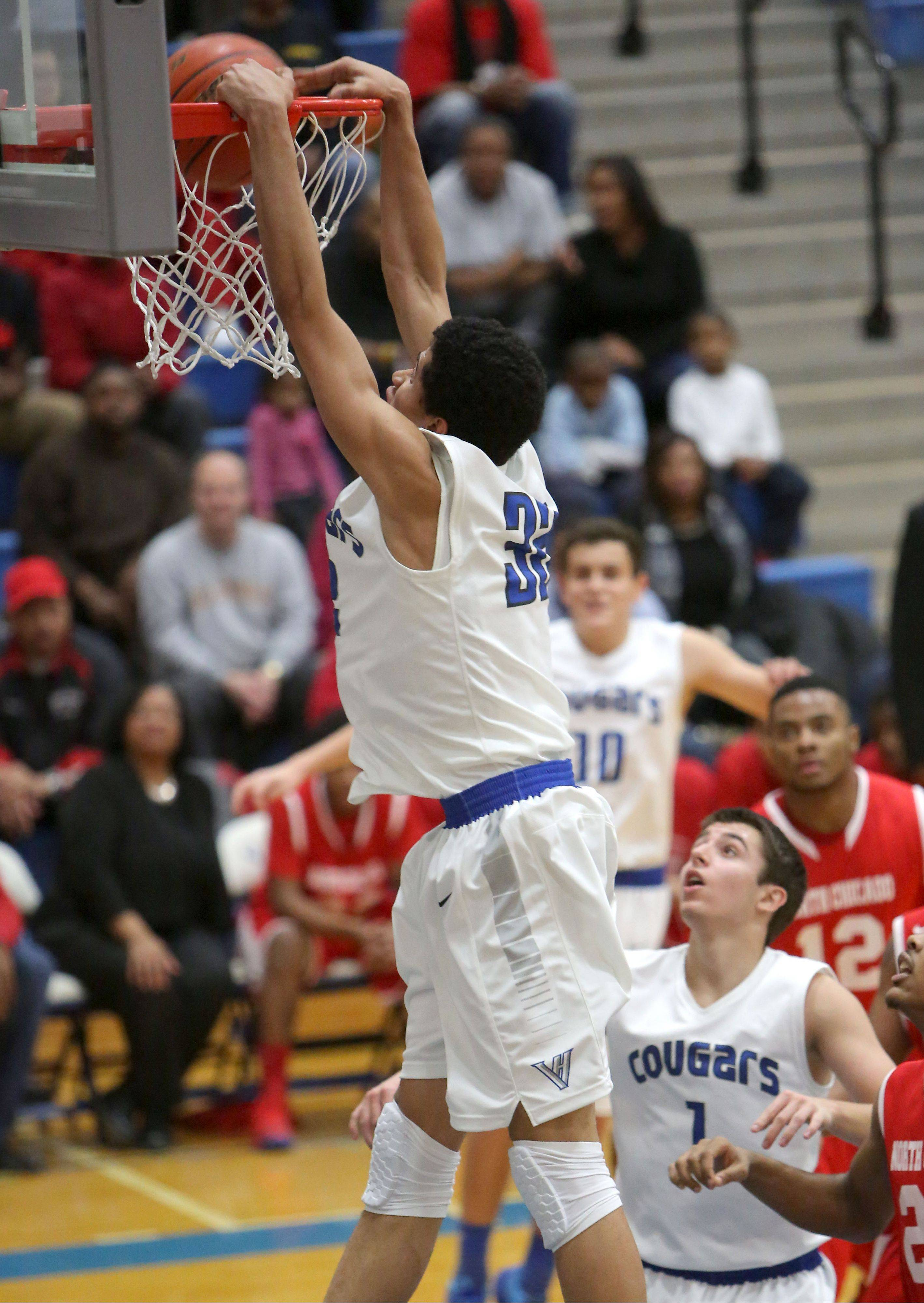 Vernon Hills' Lem Turner goes in for a dunk against North Chicago on Tuesday night in Vernon Hills.
