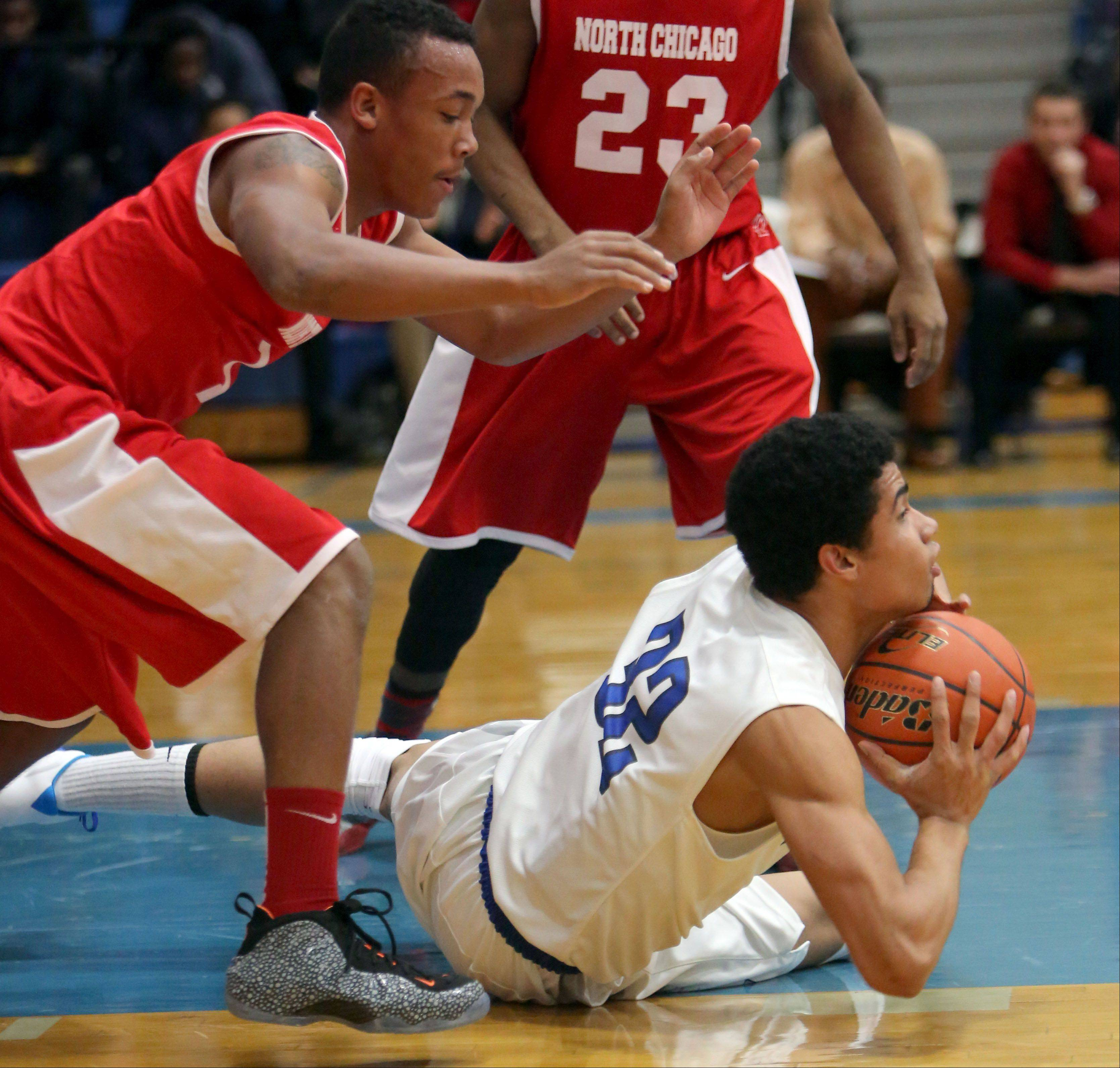 Vernon Hills' Lem Turner, right, battles for a rebound with North Chicago's Arnold Shead on Tuesday night in Vernon Hills.