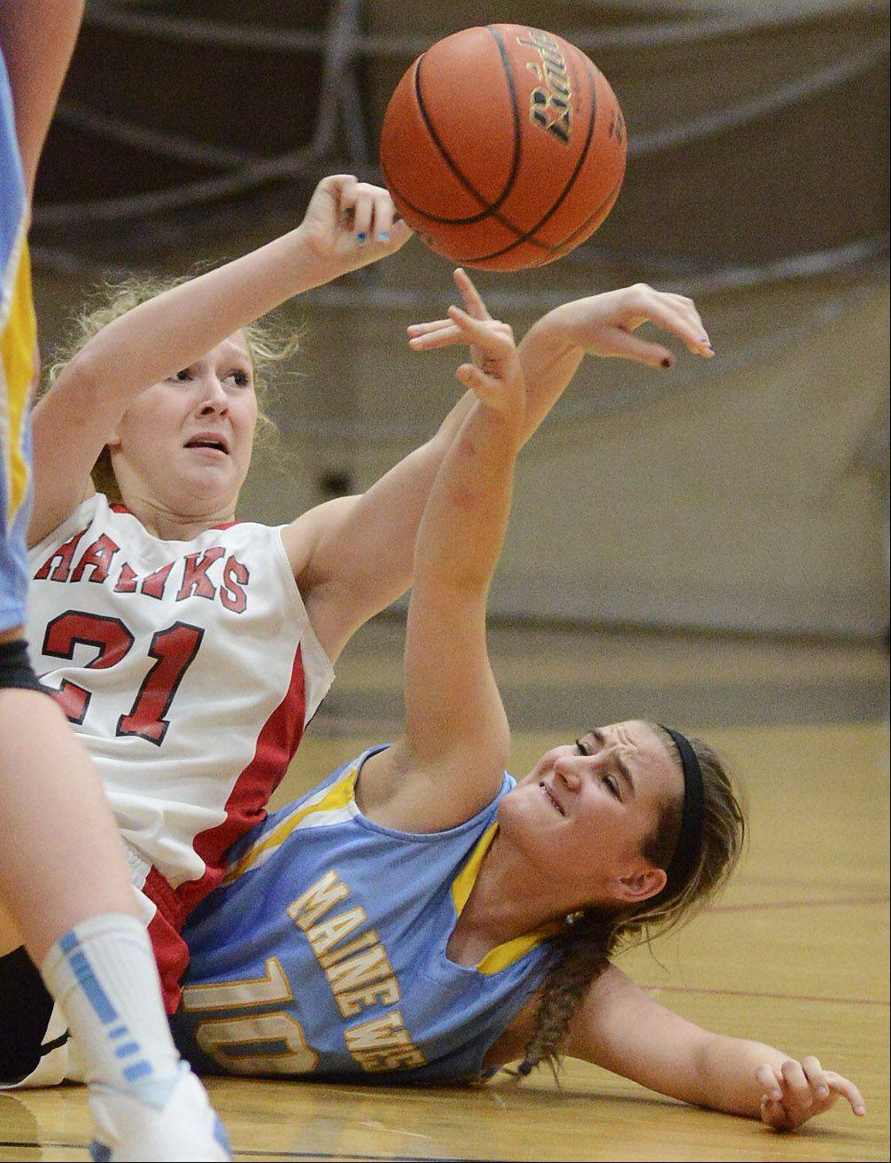 Maine South's Megan Roberts, left, and Maine West's Erin Ross dive to the floor for a loose ball.