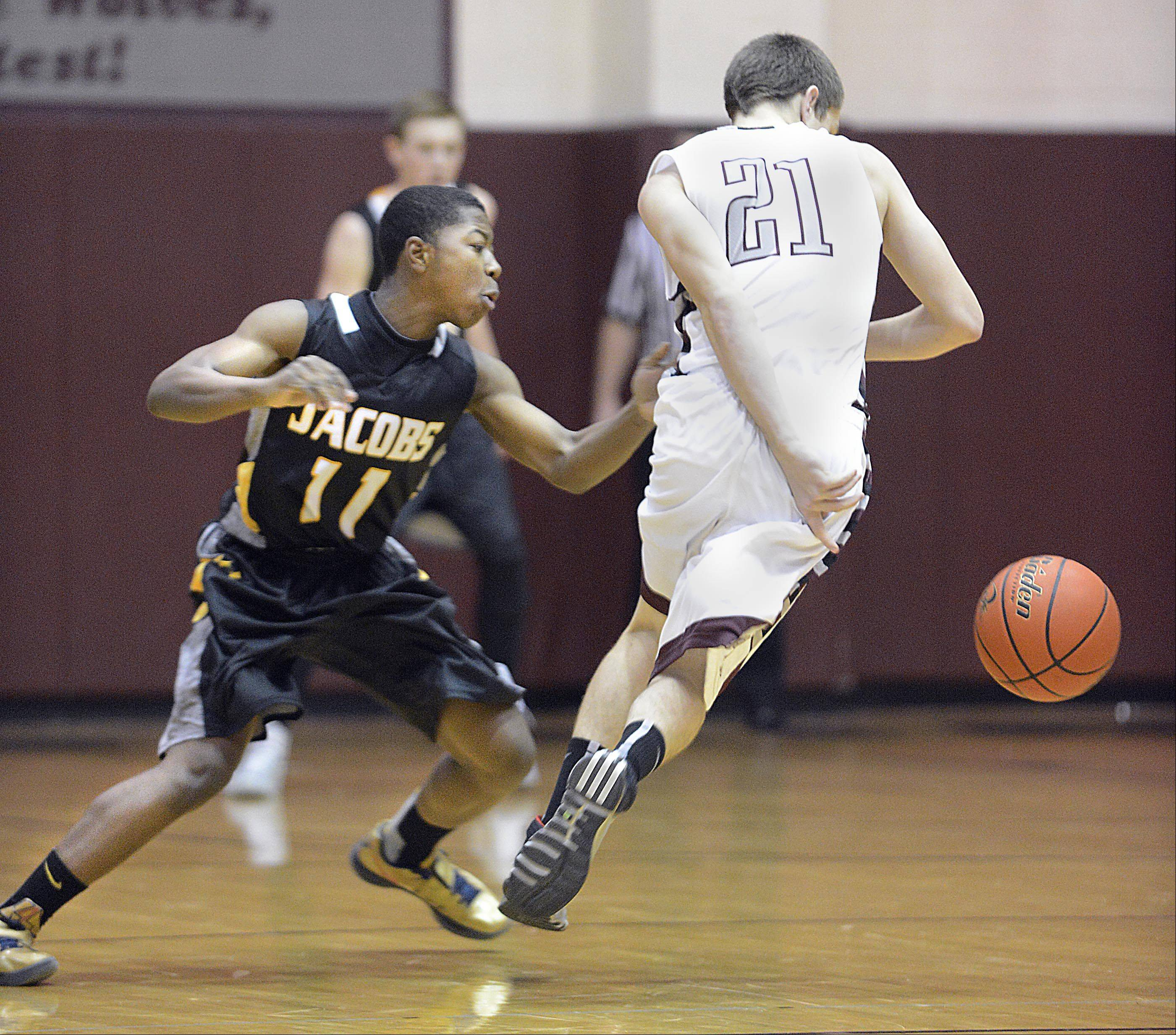 Prairie Ridge's Matt Perhats dribbles around Jacobs' Mike Canady.